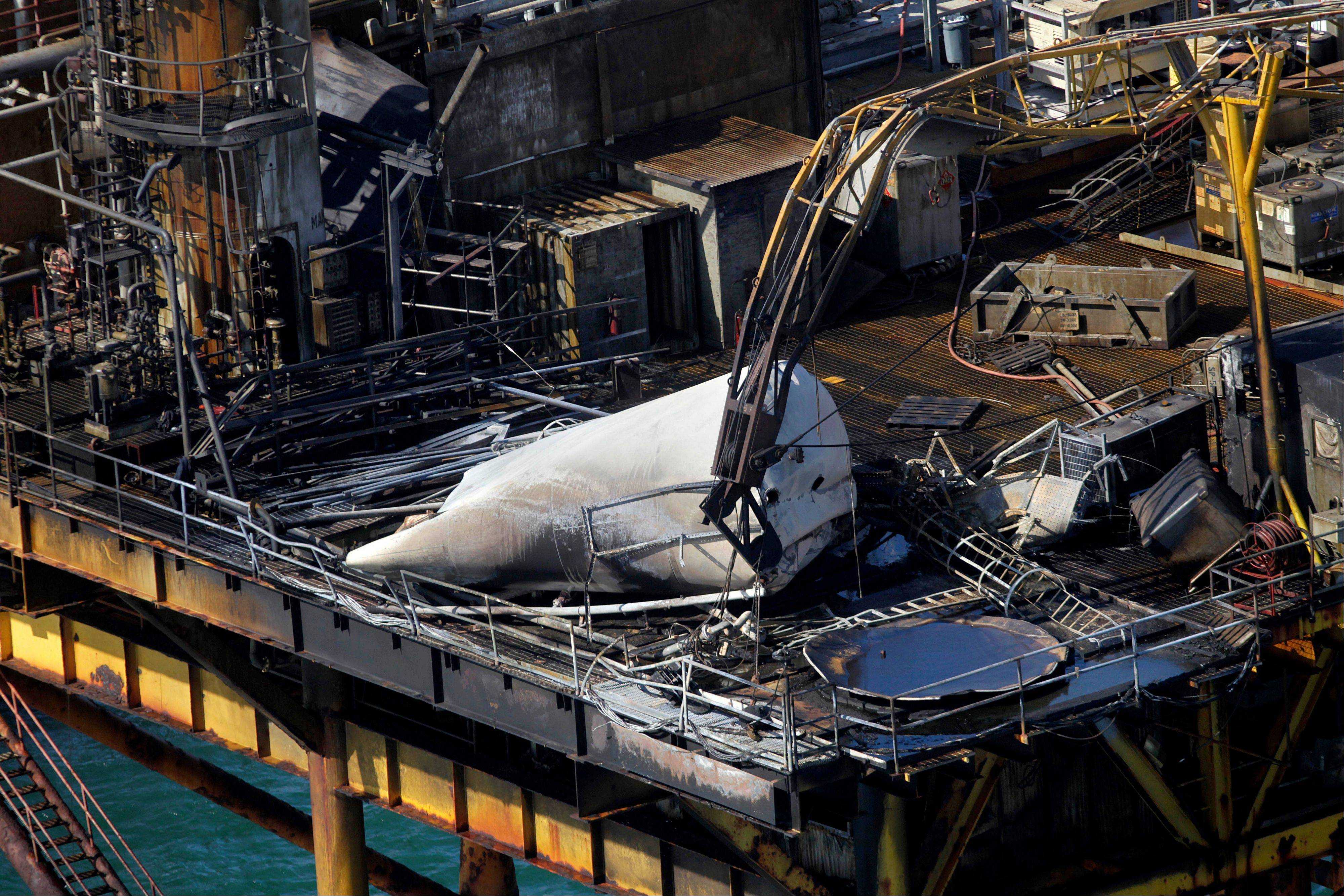 This aerial photograph shows damage from an explosion and fire on an oil rig in the Gulf of Mexico, about 25 miles southeast of Grand Isle, La., Friday.