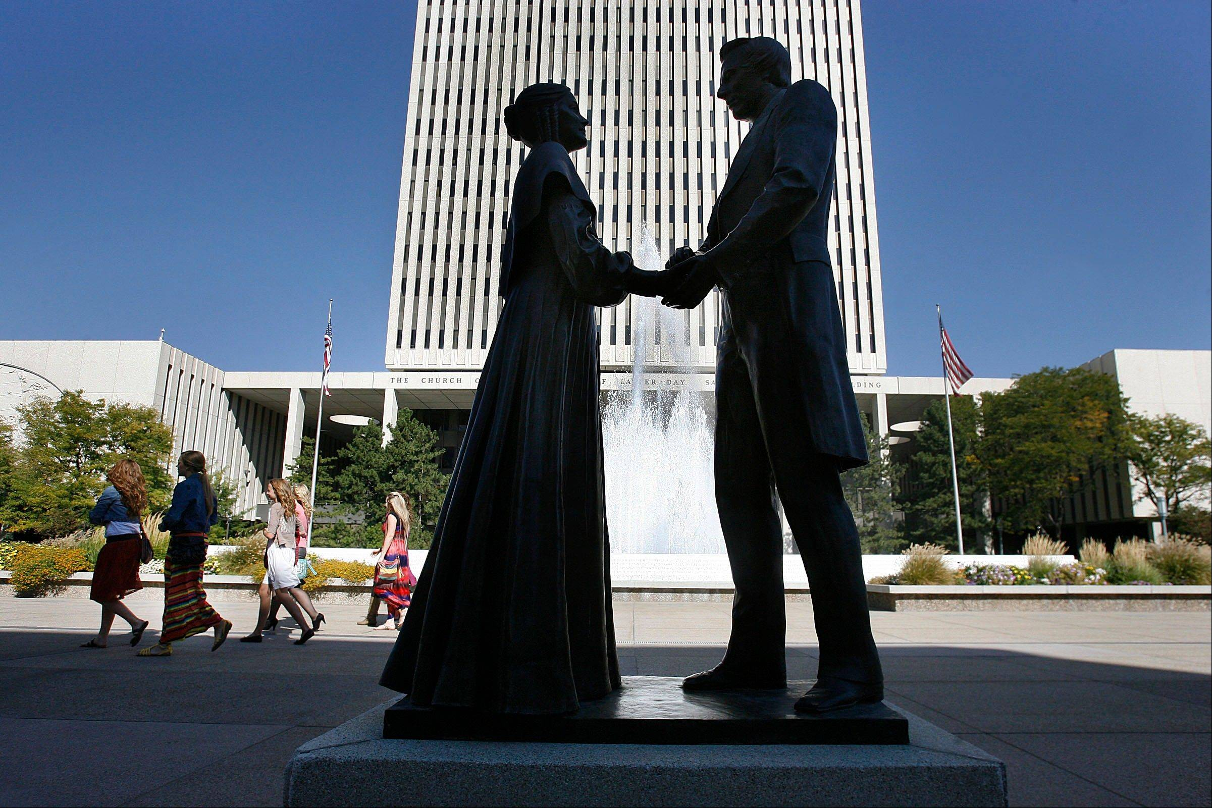 Women walk by a statue of Joseph and Emma Smith outside the church office building during the 182nd Semiannual General Conference for The Church of Jesus Christ of Latter-day Saints in Salt Lake City. The Church of Jesus Christ of Latter-day Saints has entered a new era after Mitt Romney's run for president in 2012. His candidacy illuminated a changing landscape for the religion, where Americans are growing more curious than fearful about the faith, and allies can be found even among Christians with deep misgivings about Mormon beliefs.