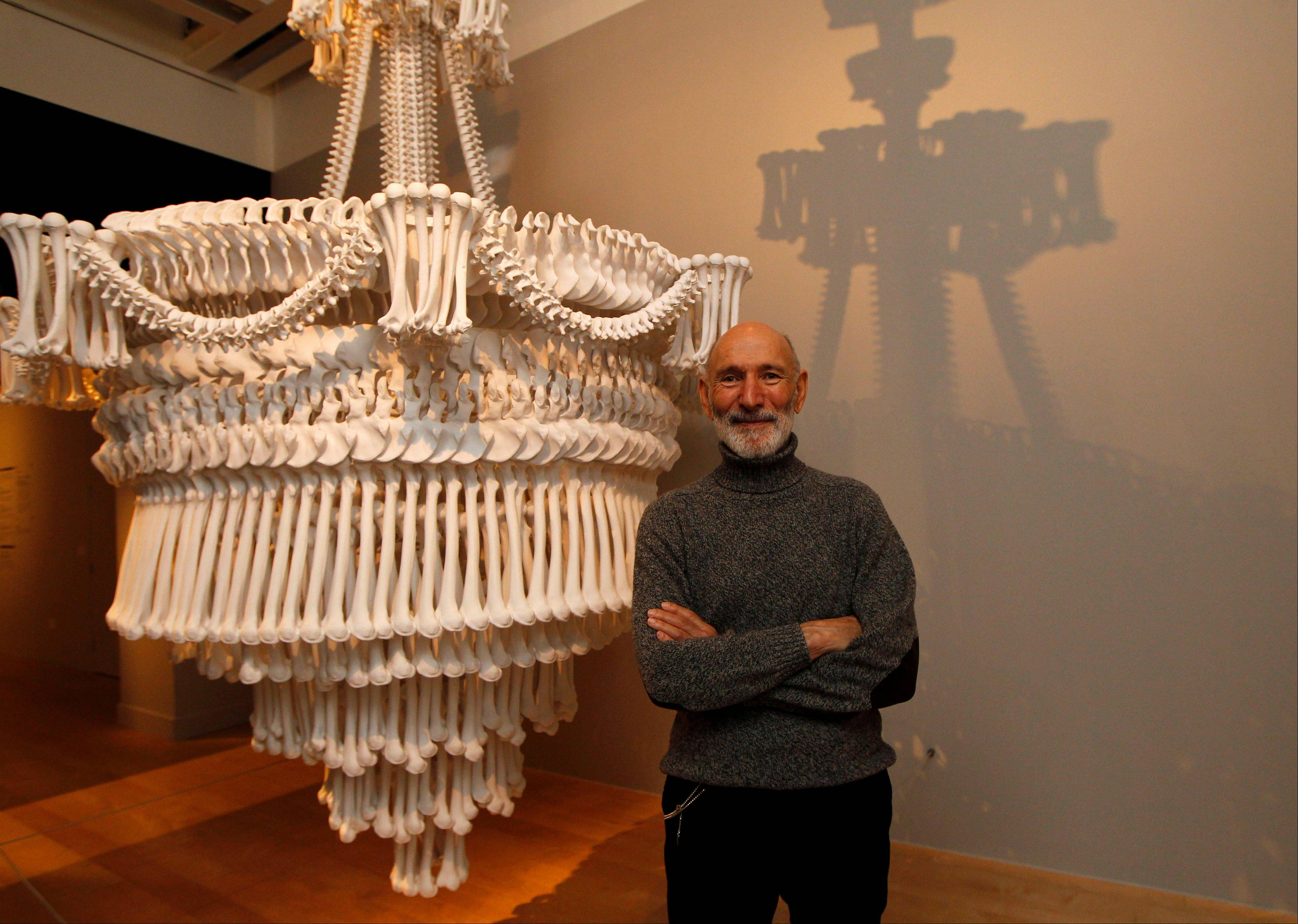 Collector Richard Harris poses with one of his collection of installation 'In the Eyes of Others' by British artist Jodie Carey on display at an exhibition 'Death: The Richard Harris Collection' at the Wellcome Collection gallery in London.