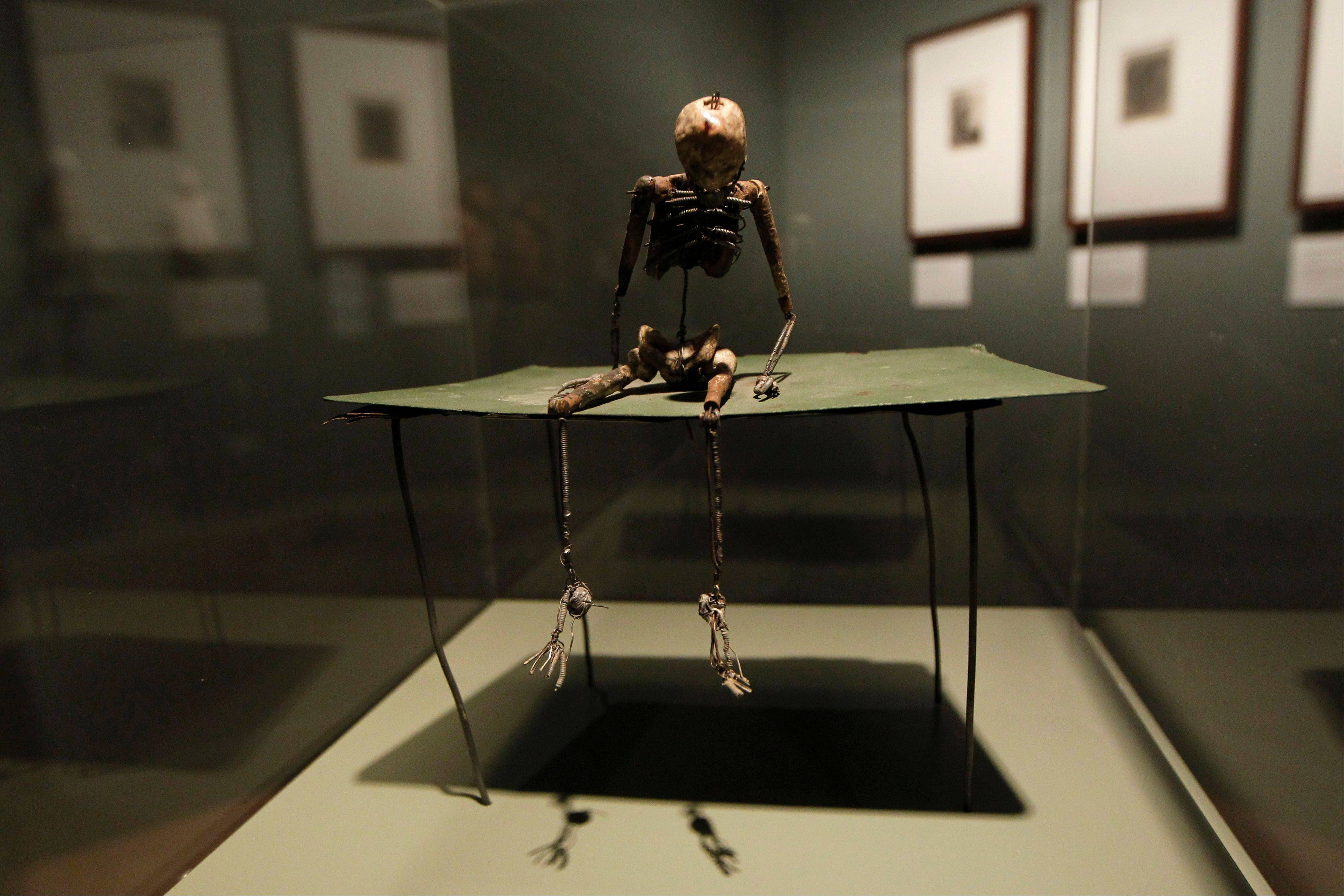 A sculpture 'Gentleman on Green Table' by U.S. artist June Leaf is seen on display at an exhibition 'Death: The Richard Harris Collection' at the Wellcome Collection gallery in London.