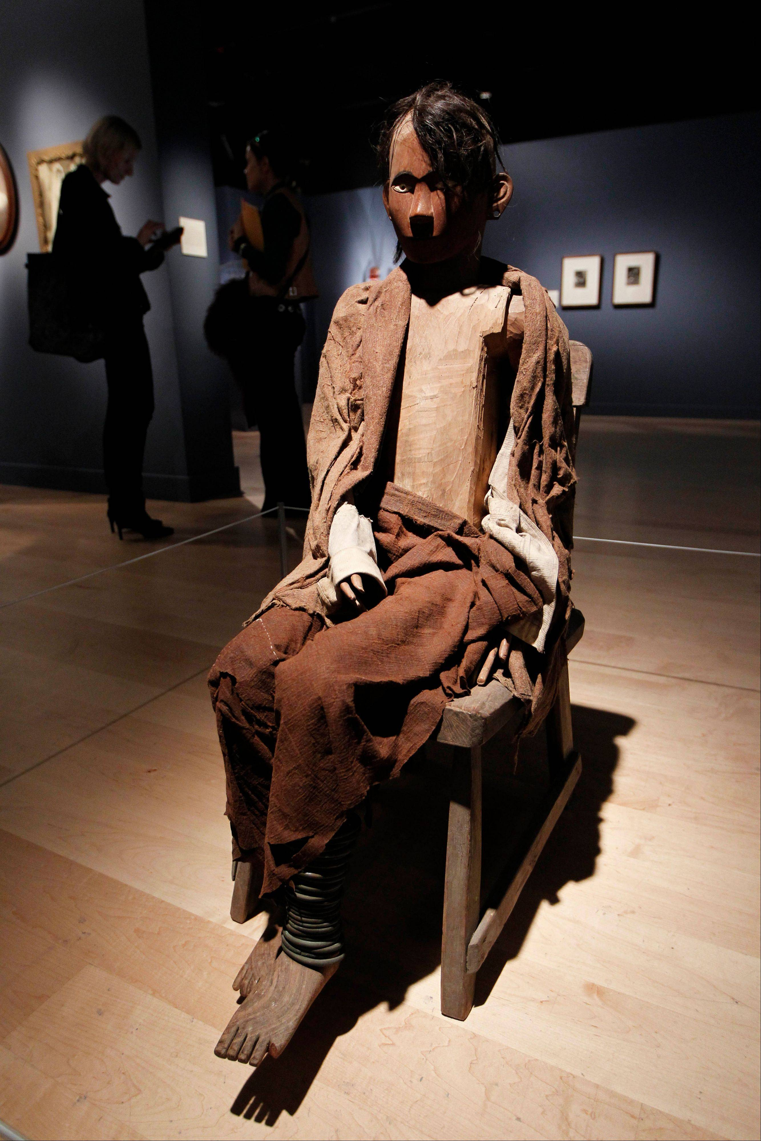 An Indonesian Tau-Tau memorial sculpture is seen on display at an exhibition 'Death: The Richard Harris Collection' at the Wellcome Collection gallery in London.