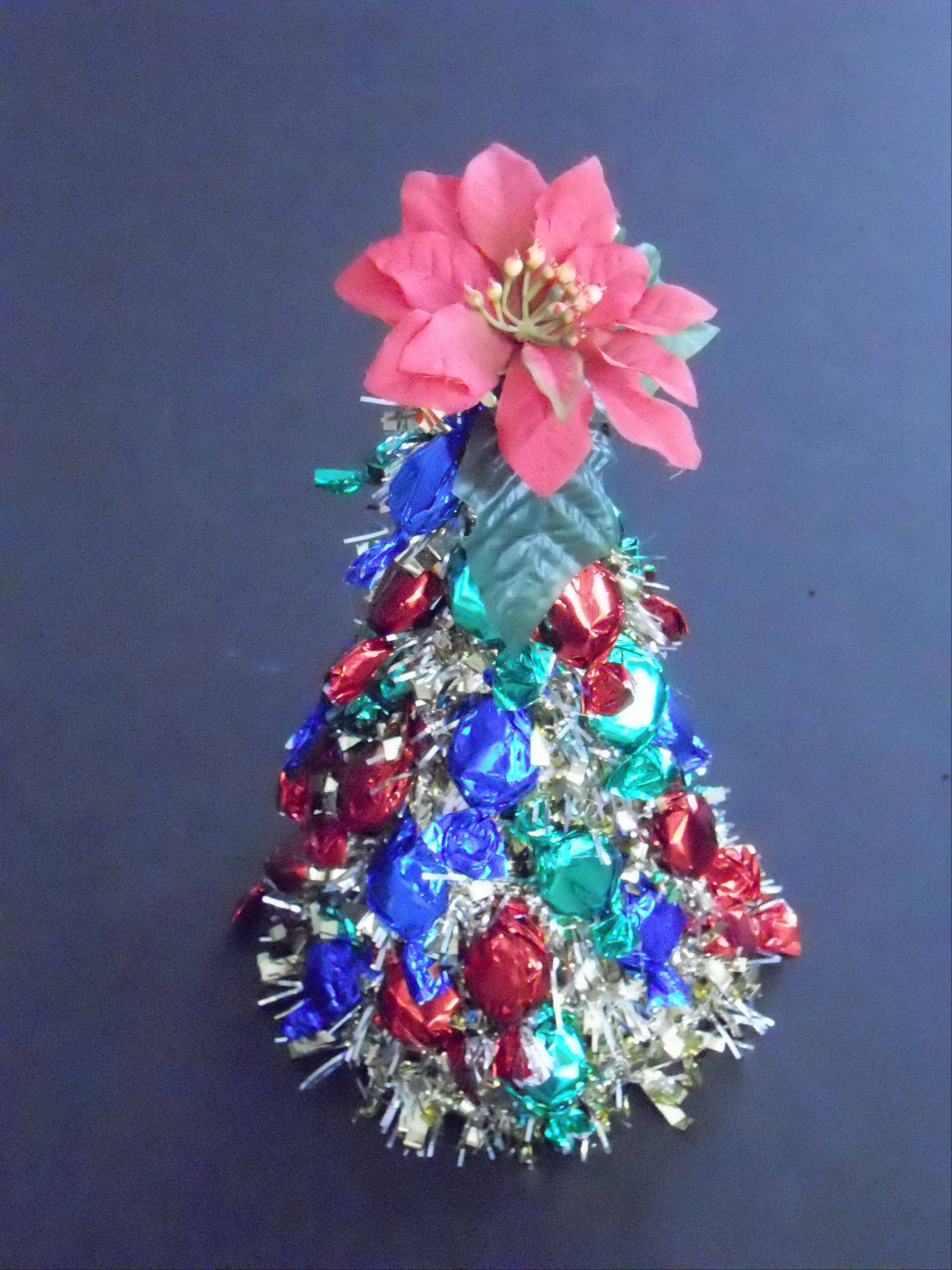 Glittery, foil wrapped candies embellish Carla Weeks shimmering edible Christmas tree.