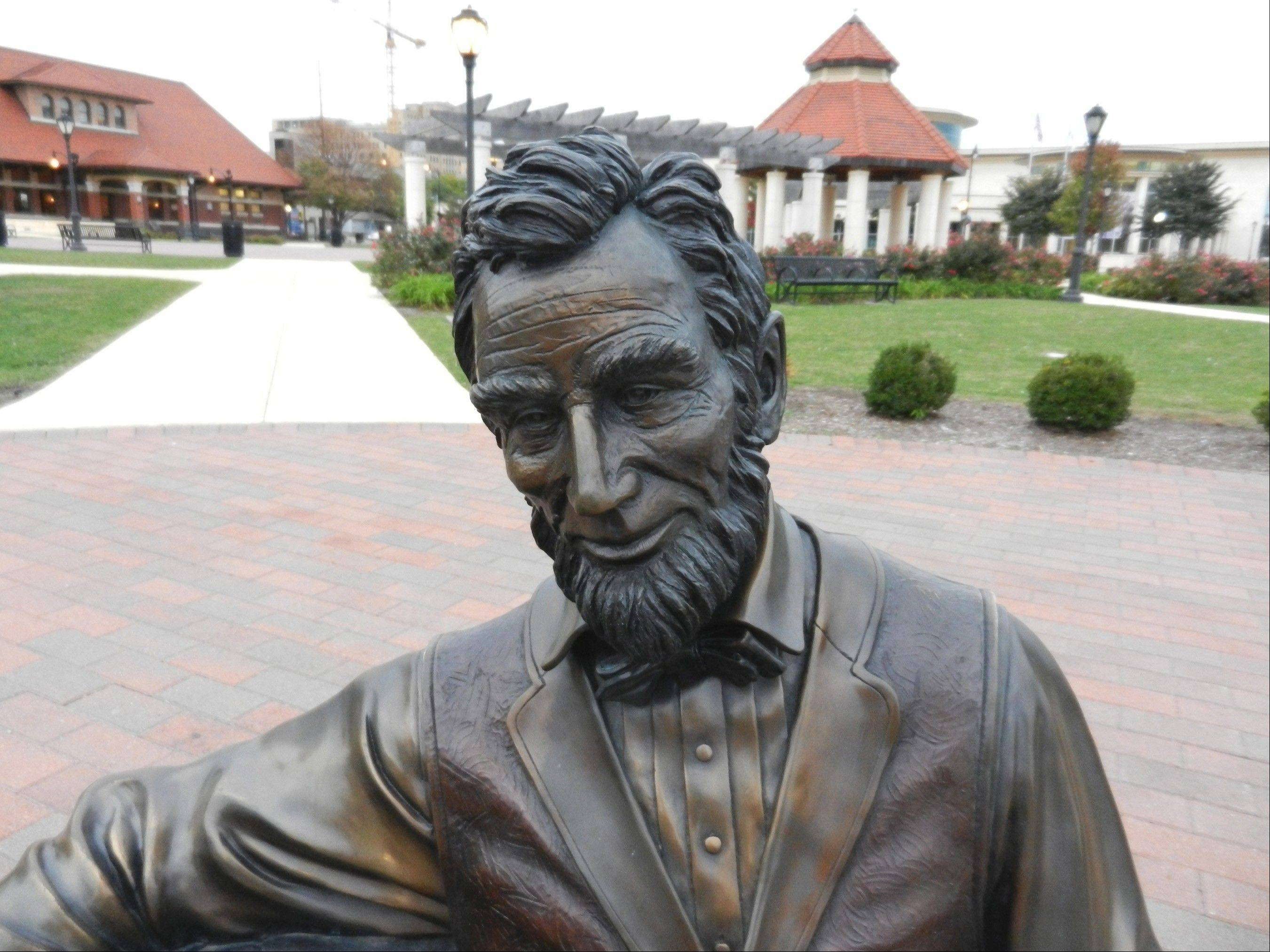 One of many statues honoring Abraham Lincoln in Springfield is in Union Square Park. In the background is the Abraham Lincoln Presidential Library and Museum, right, and the Union Station Visitor Center.