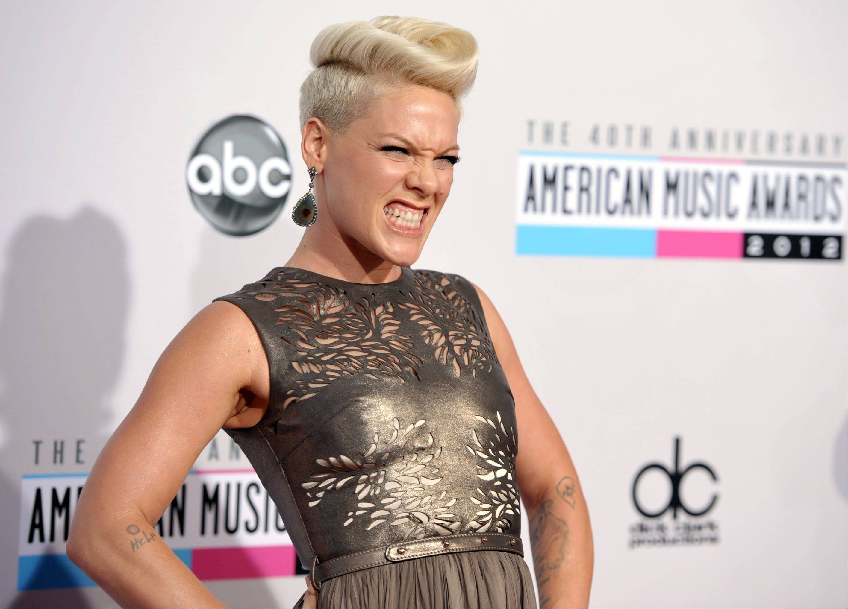 Pink shows a little attitude along the red carpet.