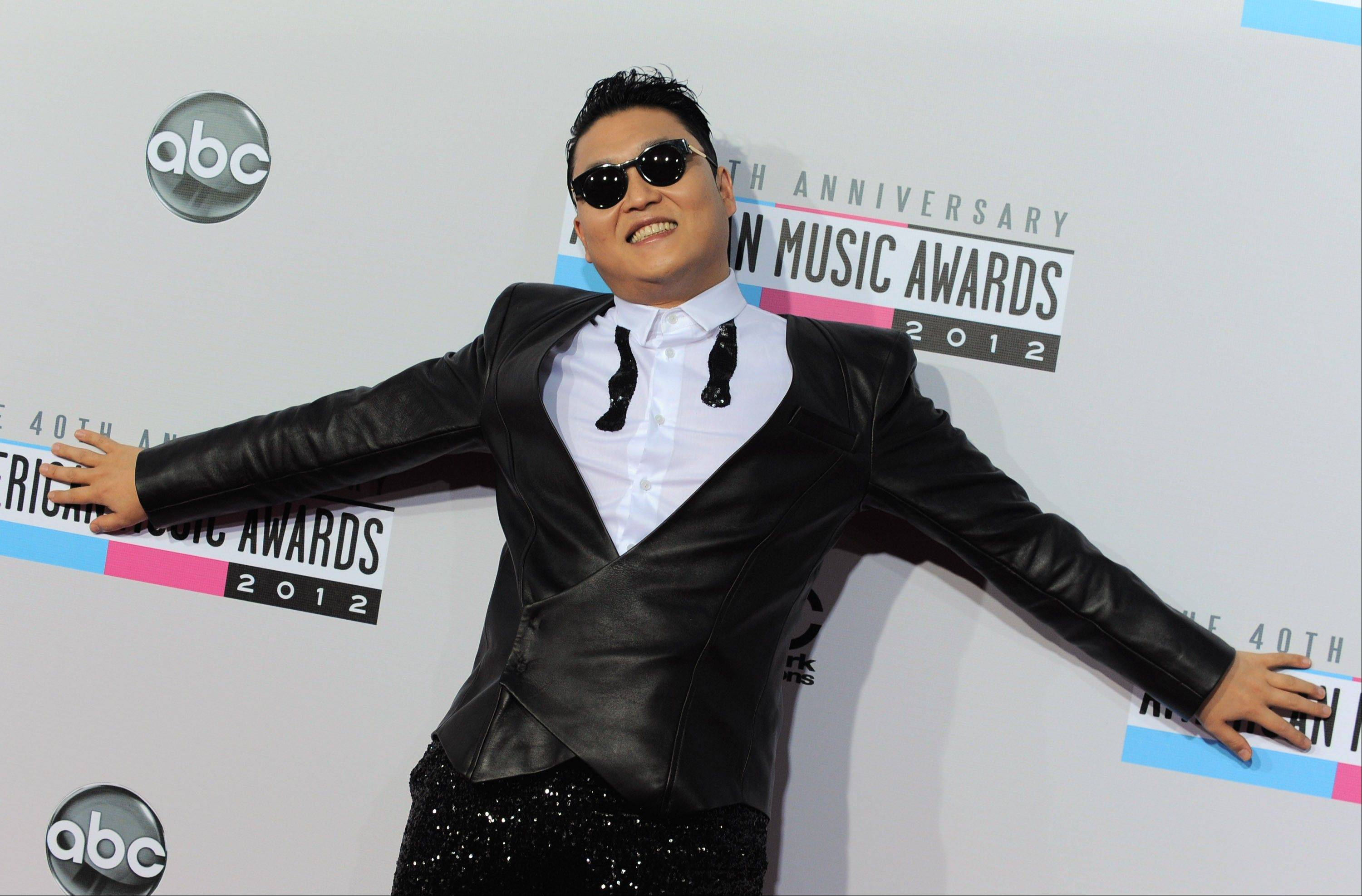 South Korean rapper PSY arrives at the 40th Anniversary American Music Awards on Sunday, Nov. 18, 2012, in Los Angeles.