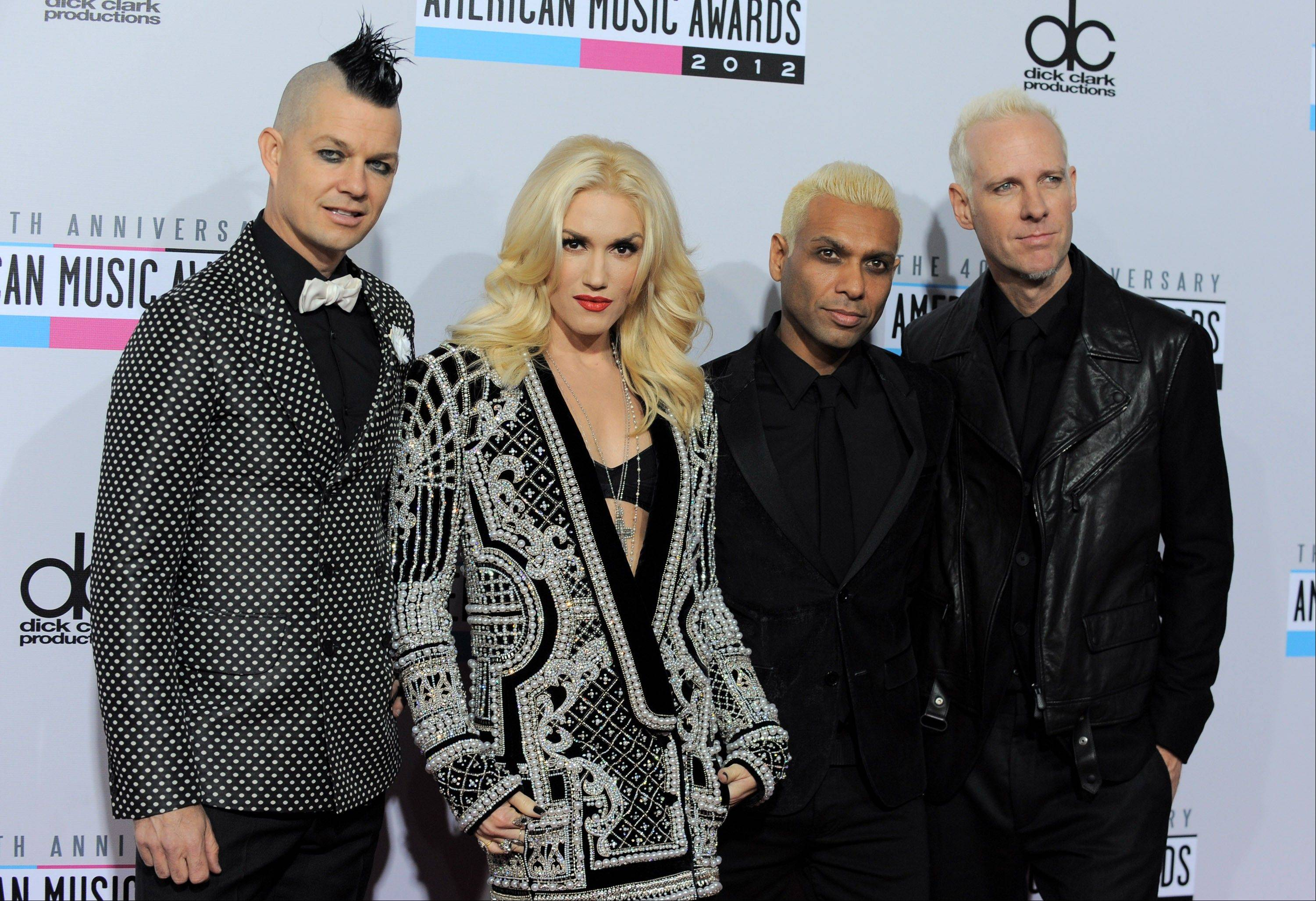Musical group No Doubt, from left, Adrian Young, Gwen Stefani, Tony Kanal and Tom Dumont arrive at the 40th Anniversary American Music Awards.