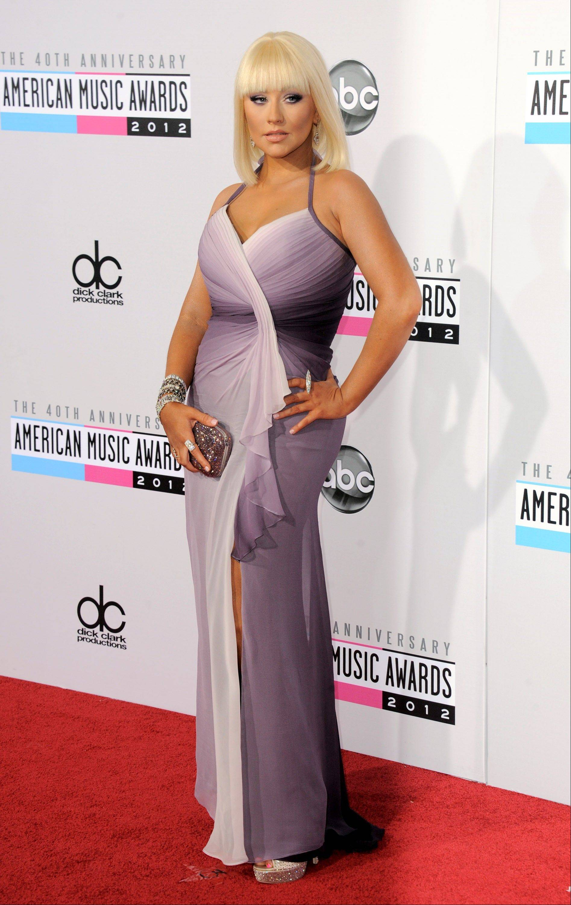 "Singer and ""The Voice"" judge Christina Aguilera strikes a glamorous pose outside of the AMAs."