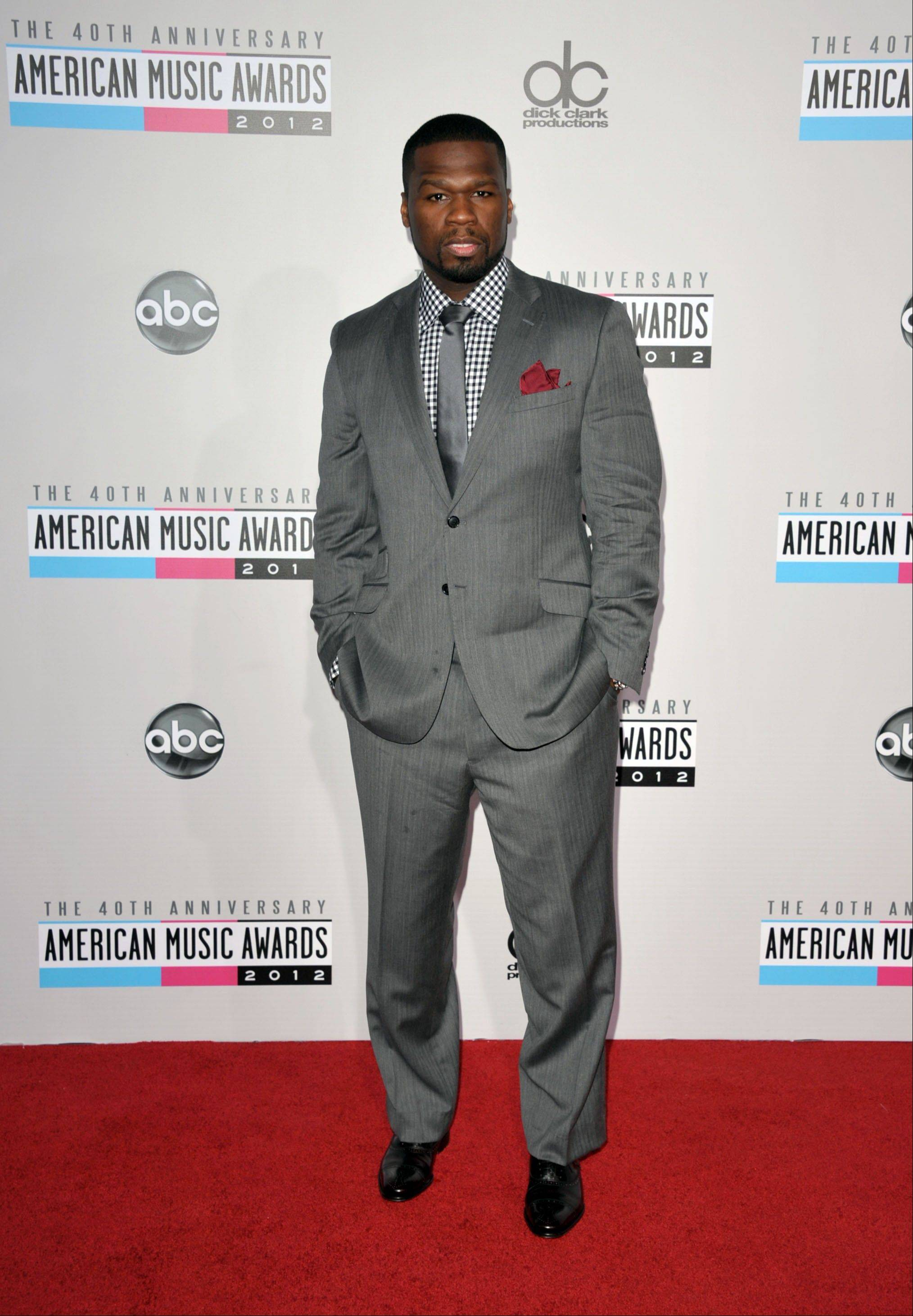 50 Cent aka Curtis Jackson arrives at the 40th Anniversary American Music Awards on Sunday, Nov. 18, 2012, in Los Angeles.