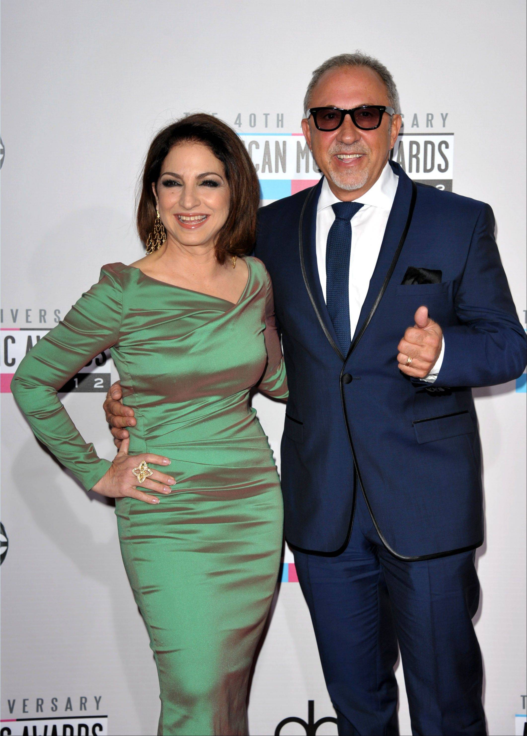 Gloria Estefan, left, and Emilio Estefan Jr. arrive at the 40th Anniversary American Music Awards on Sunday, Nov. 18, 2012, in Los Angeles.