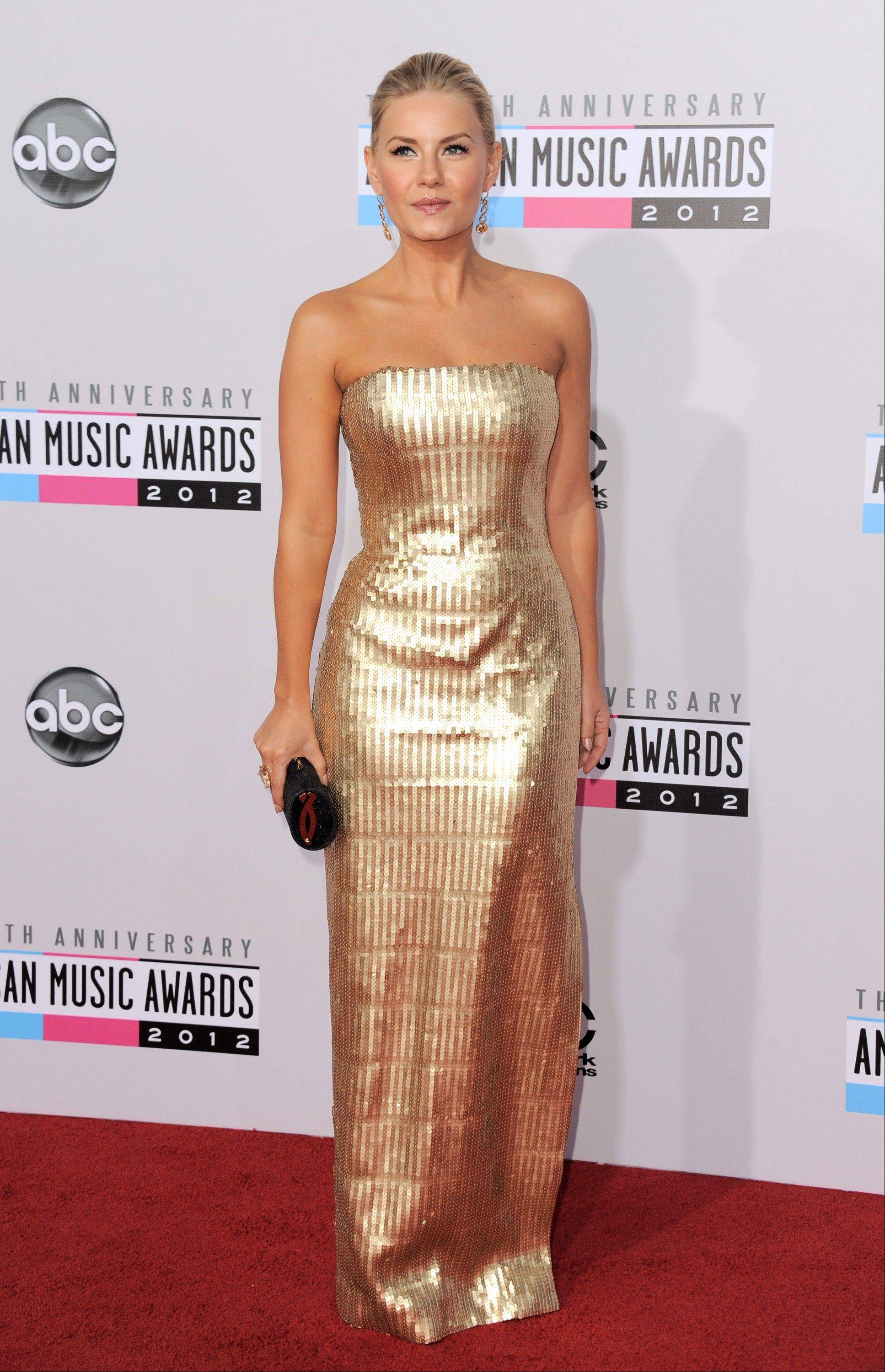 """Happy Endings"" actress Elisha Cuthbert arrives at the 40th Anniversary American Music Awards on Sunday, Nov. 18, 2012, in Los Angeles."