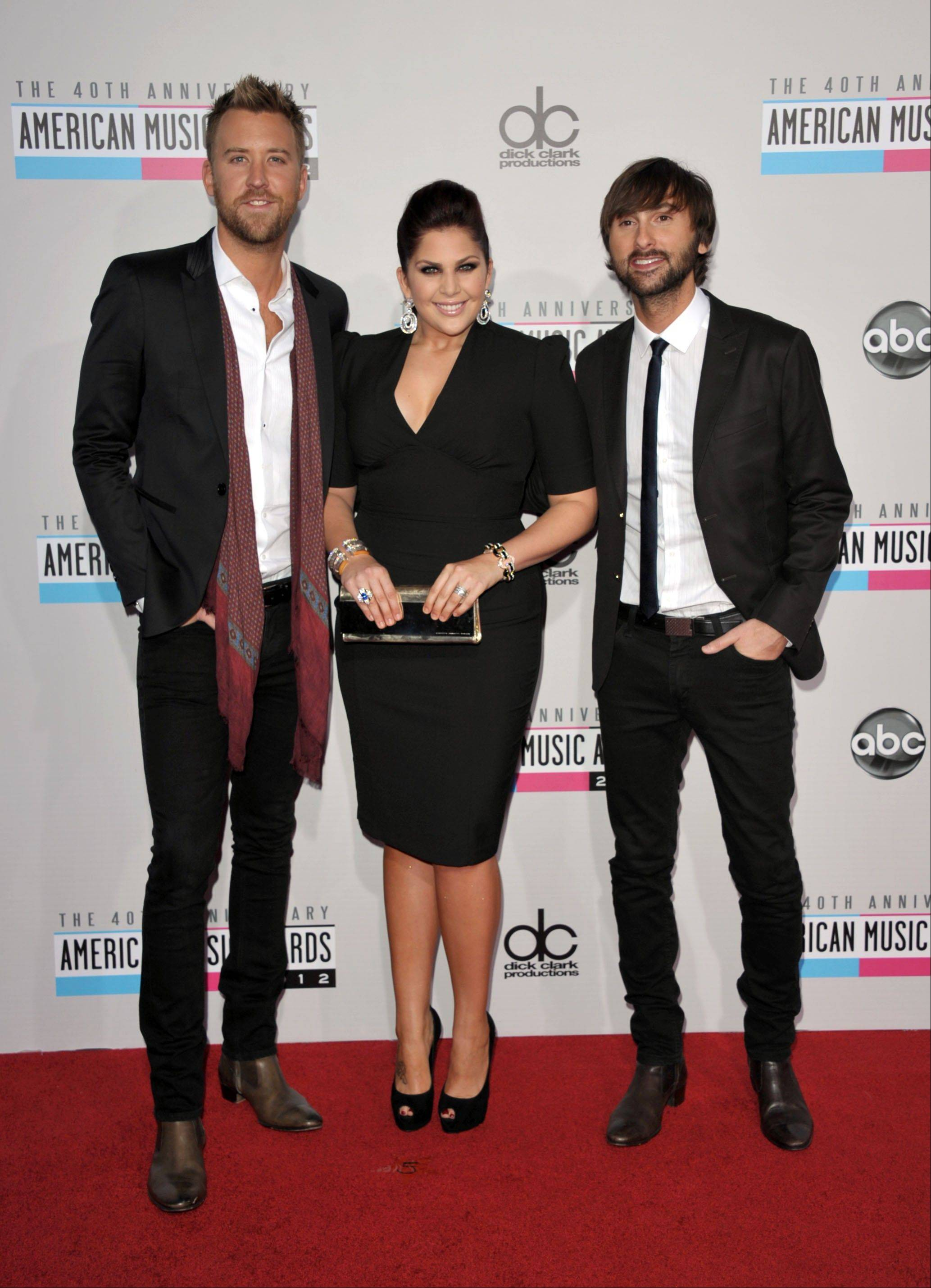 Charles Kelley, left, Hillary Scott, center, and Dave Haywood from the band Lady Antebellum arrive at the 40th Anniversary American Music Awards on Sunday, Nov. 18, 2012, in Los Angeles.
