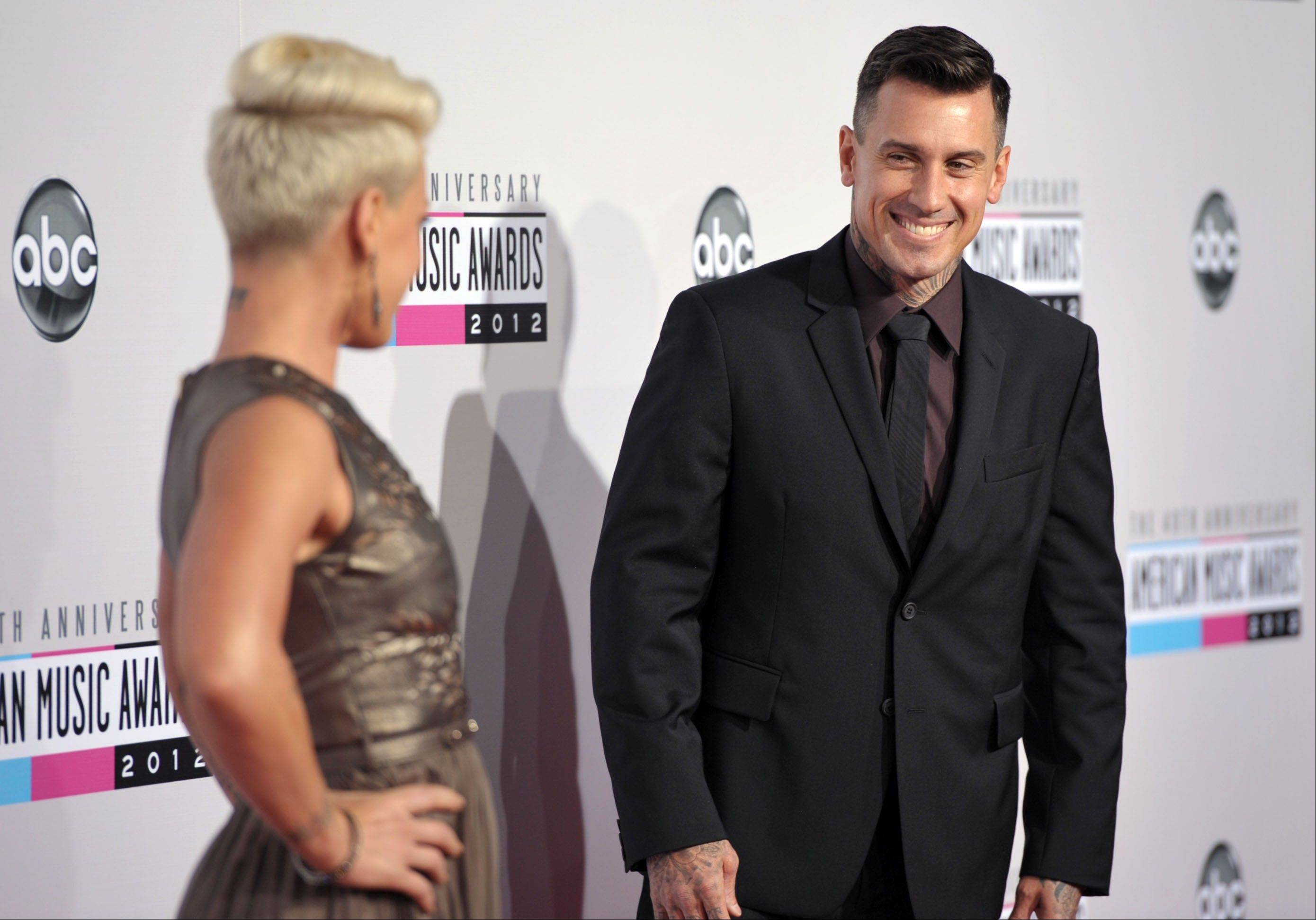 Singer Pink, left, and her husband, Carey Hart, have a little fun before they head into the AMAs.
