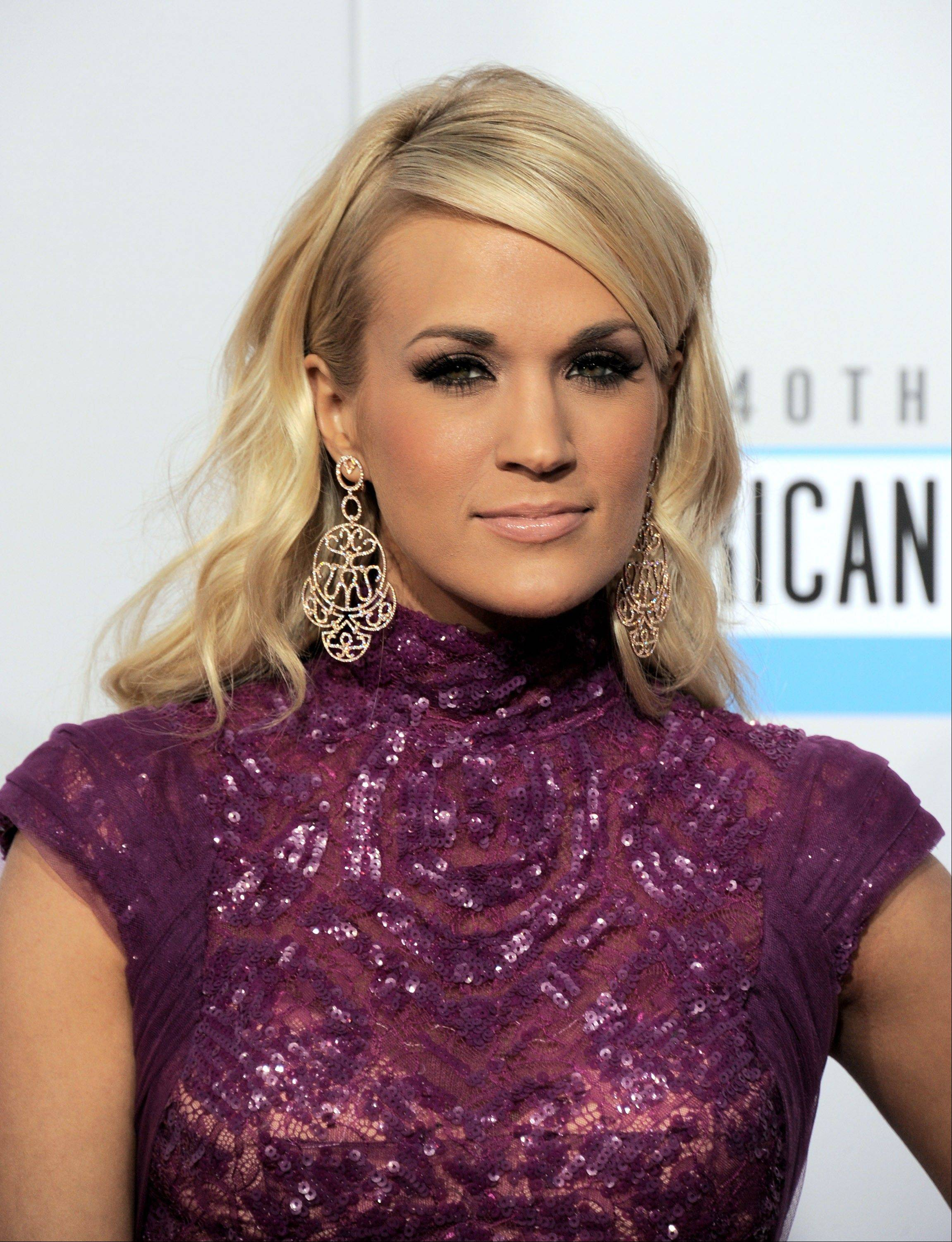 "Singer and ""American Idol"" alumna Carrie Underwood arrives at the 40th Anniversary American Music Awards."