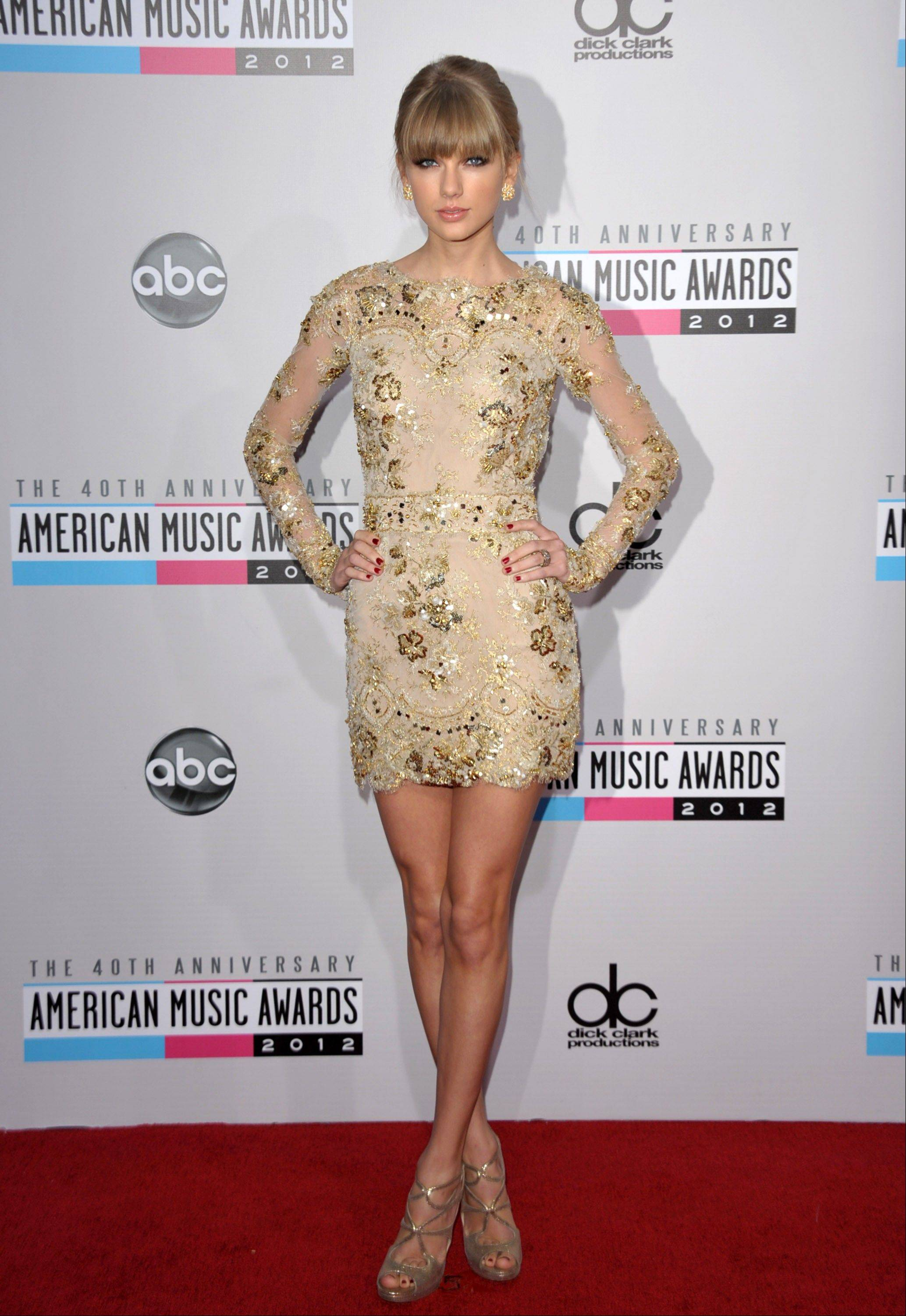 Country superstar Taylor Swift arrives at the 40th Anniversary American Music Awards on Sunday, Nov. 18, 2012, in Los Angeles.
