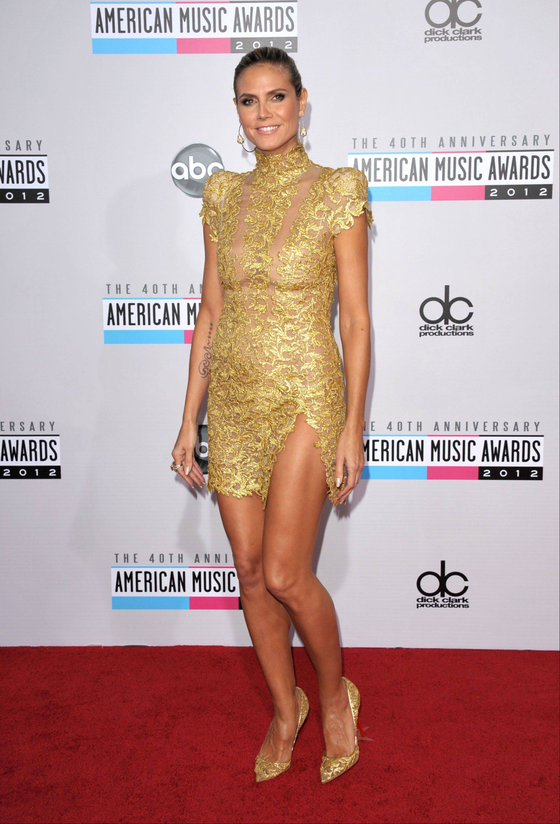 """Project Runway"" host Heidi Klum arrives at the 40th Anniversary American Music Awards on Sunday, Nov. 18, 2012, in Los Angeles."