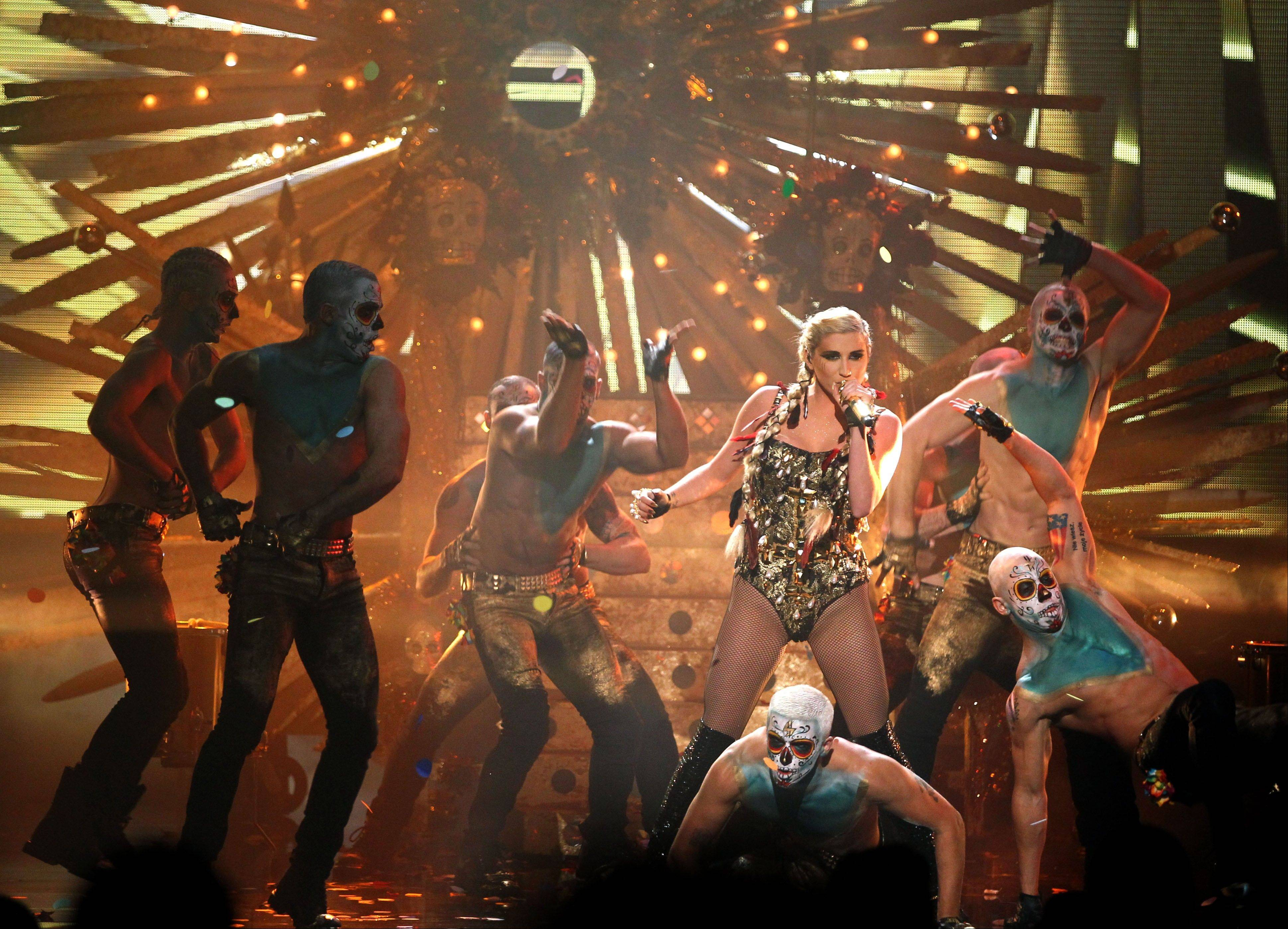 Ke$ha performs at the 40th Annual American Music Awards on Sunday, Nov. 18, 2012, in Los Angeles.