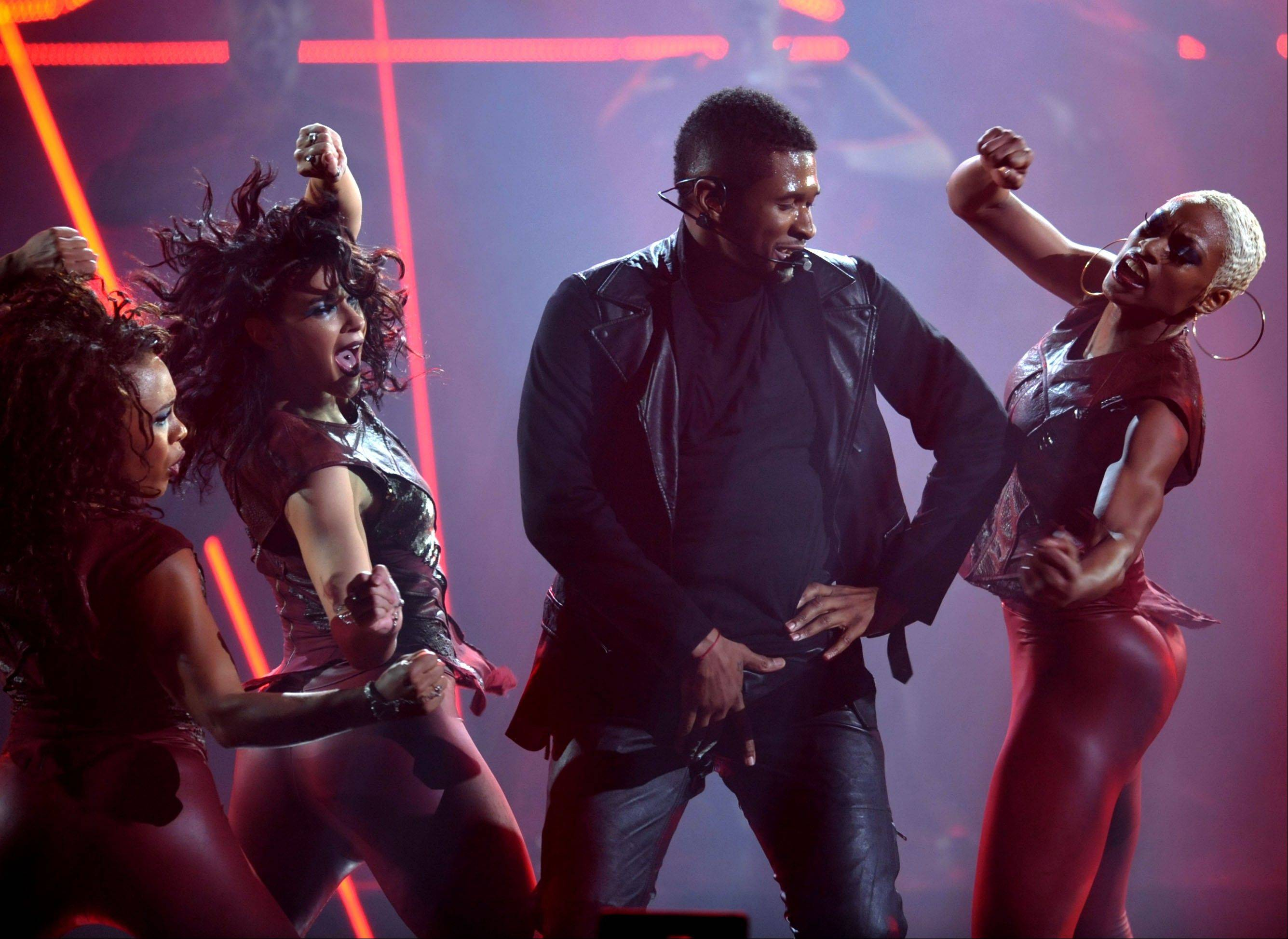 Usher performs at the 40th Annual American Music Awards on Sunday, Nov. 18, 2012, in Los Angeles.