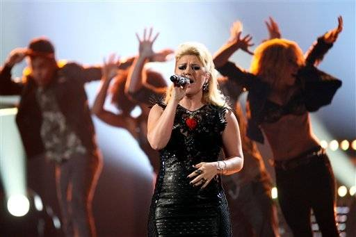 "The original ""American Idol"" Kelly Clarkson performs during the AMAs."