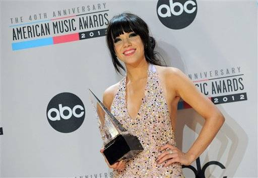 Carly Rae Jepsen holds her award for favorite new artist at the AMAs.