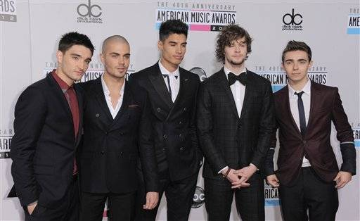 Members of The Wanted, from left, Tom Parker, Max George, Siva Kaneswaran, Jay McGuiness and Nathan Sykes arrive at the 40th Anniversary American Music Awards on Sunday, Nov. 18, 2012, in Los Angeles.