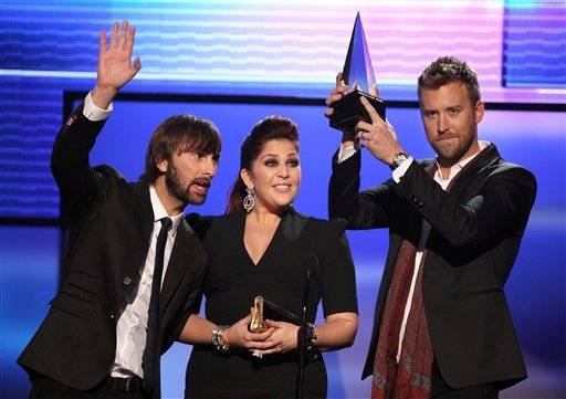 Dave Haywood, from left, Hillary Scott and Charles Kelley, left to right, from the band Lady Antebellum accept the award for favorite band, duo or group - country at the 40th Anniversary American Music Awards on Sunday, Nov. 18, 2012, in Los Angeles.