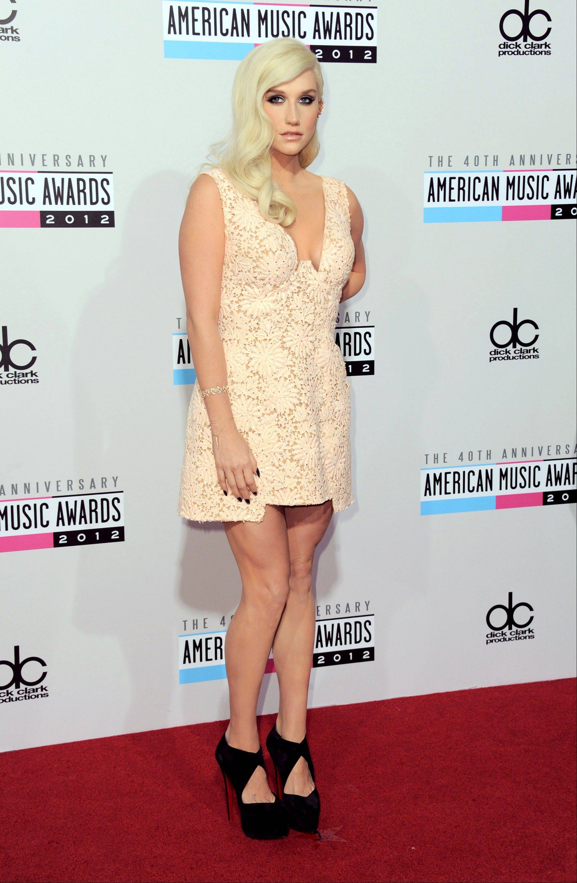 Ke$ha arrives at the 40th Anniversary American Music Awards on Sunday, Nov. 18, 2012, in Los Angeles.