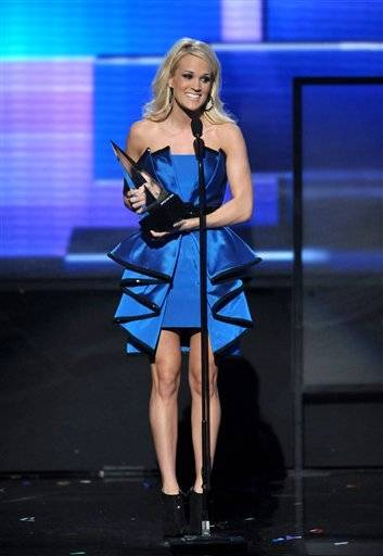 "Carrie Underwood accepts the award for favorite album - country for ""Blown Away"" at the 40th Anniversary American Music Awards on Sunday, Nov. 18, 2012, in Los Angeles."