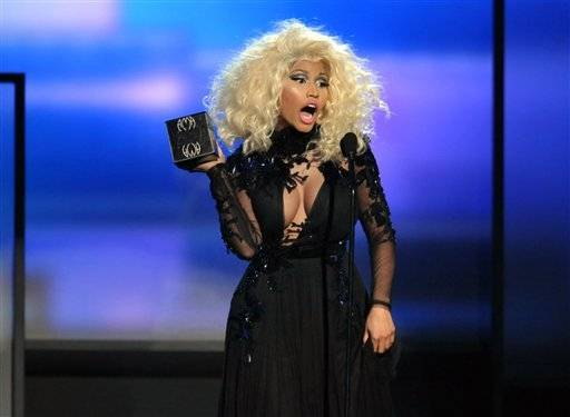 Nicki Minaj accepts the award for favorite artist - rap/hip-hop at the 40th Anniversary American Music Awards on Sunday, Nov. 18, 2012, in Los Angeles.
