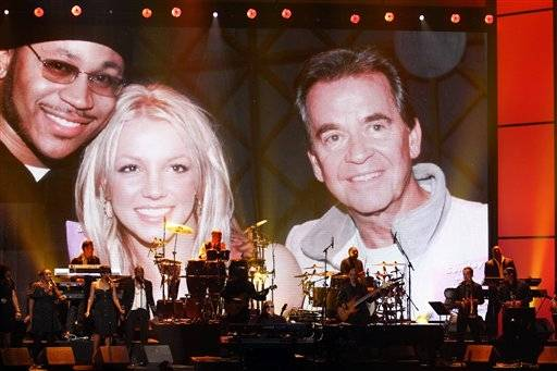 "Stevie Wonder and the Rickey Minor Band perform ""Master Blaster"", ""My Cherie Amour"" and ""Sir Duke"" as an image of Clark with Britney Spears and LL Cool J is displayed during a tribute to Dick Clark at the 40th Anniversary American Music Awards on Sunday, Nov. 18, 2012, in Los Angeles."