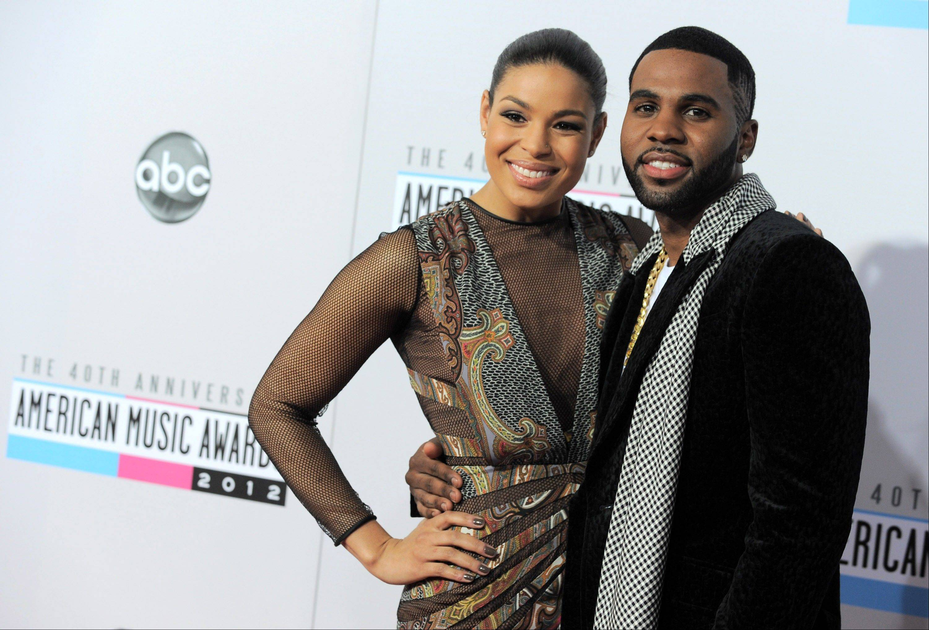 Jordin Sparks, left, and Jason Derulo arrive at the 40th Anniversary American Music Awards.