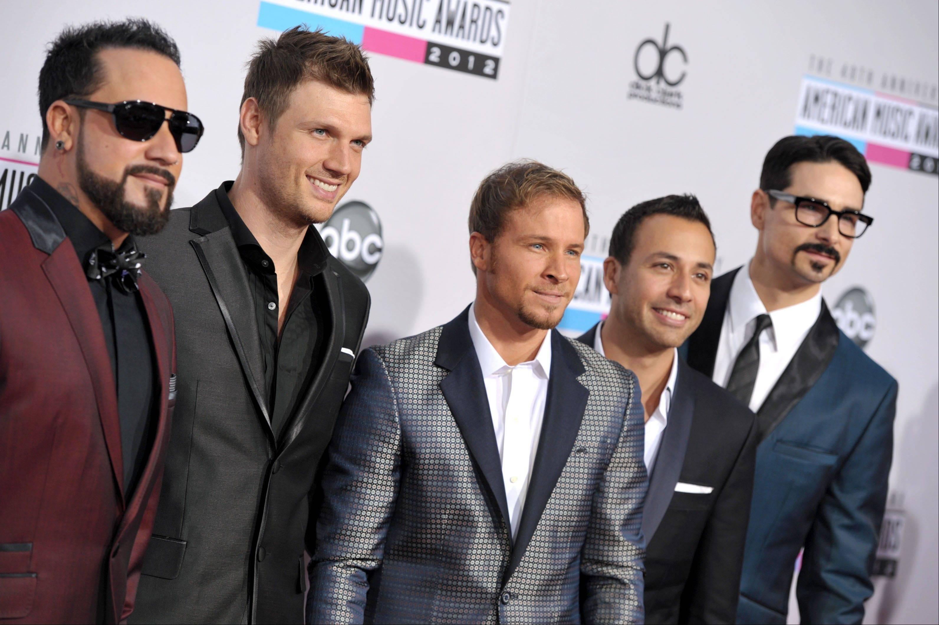 The Backstreet Boys, from left, A.J. McLean, Nick Carter, Brian Littrell, Howie Dorough, and Kevin Richardson arrive at the 40th Anniversary American Music Awards.