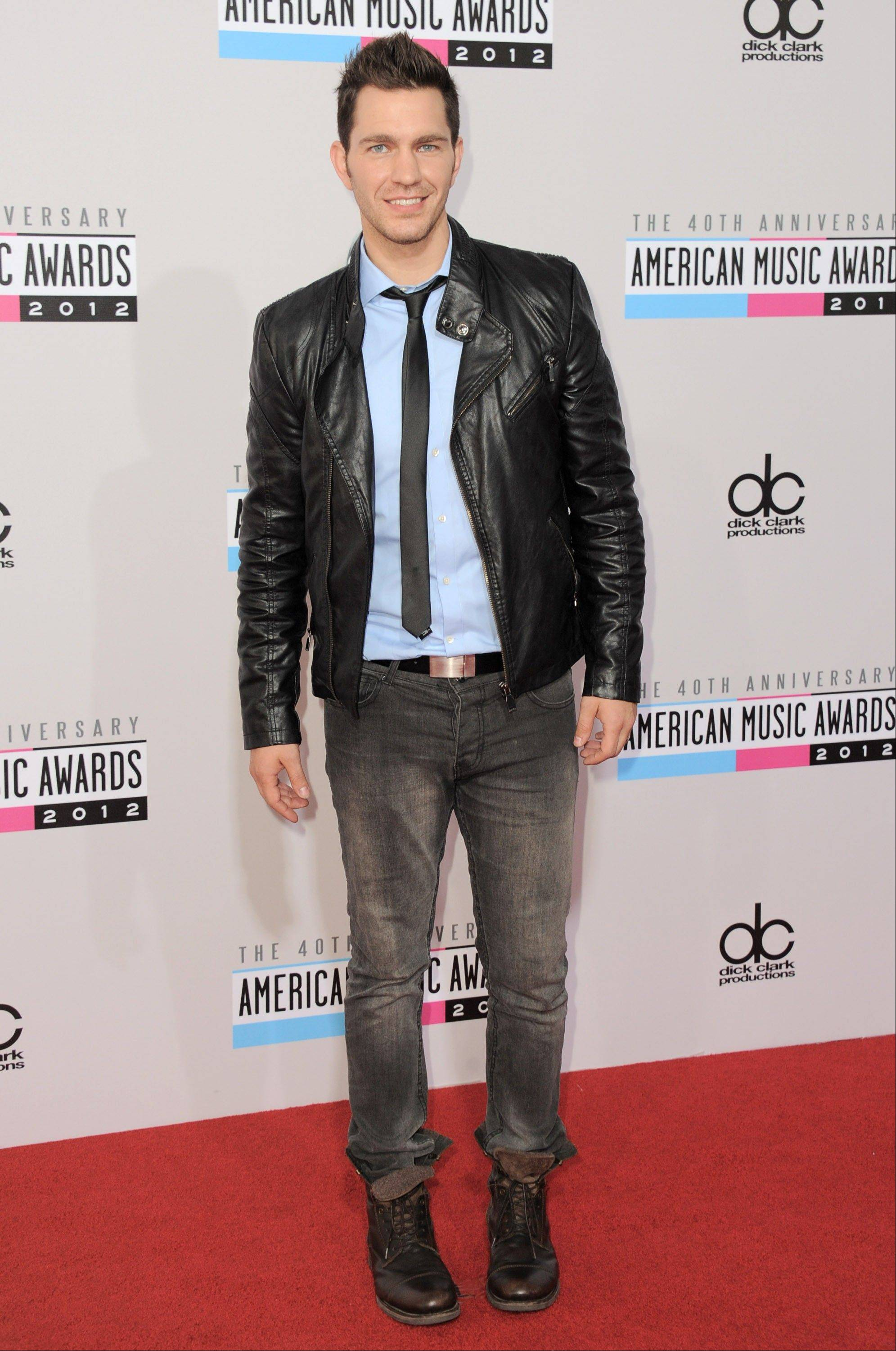 Singer Andy Grammer arrives at the 40th Anniversary American Music Awards.