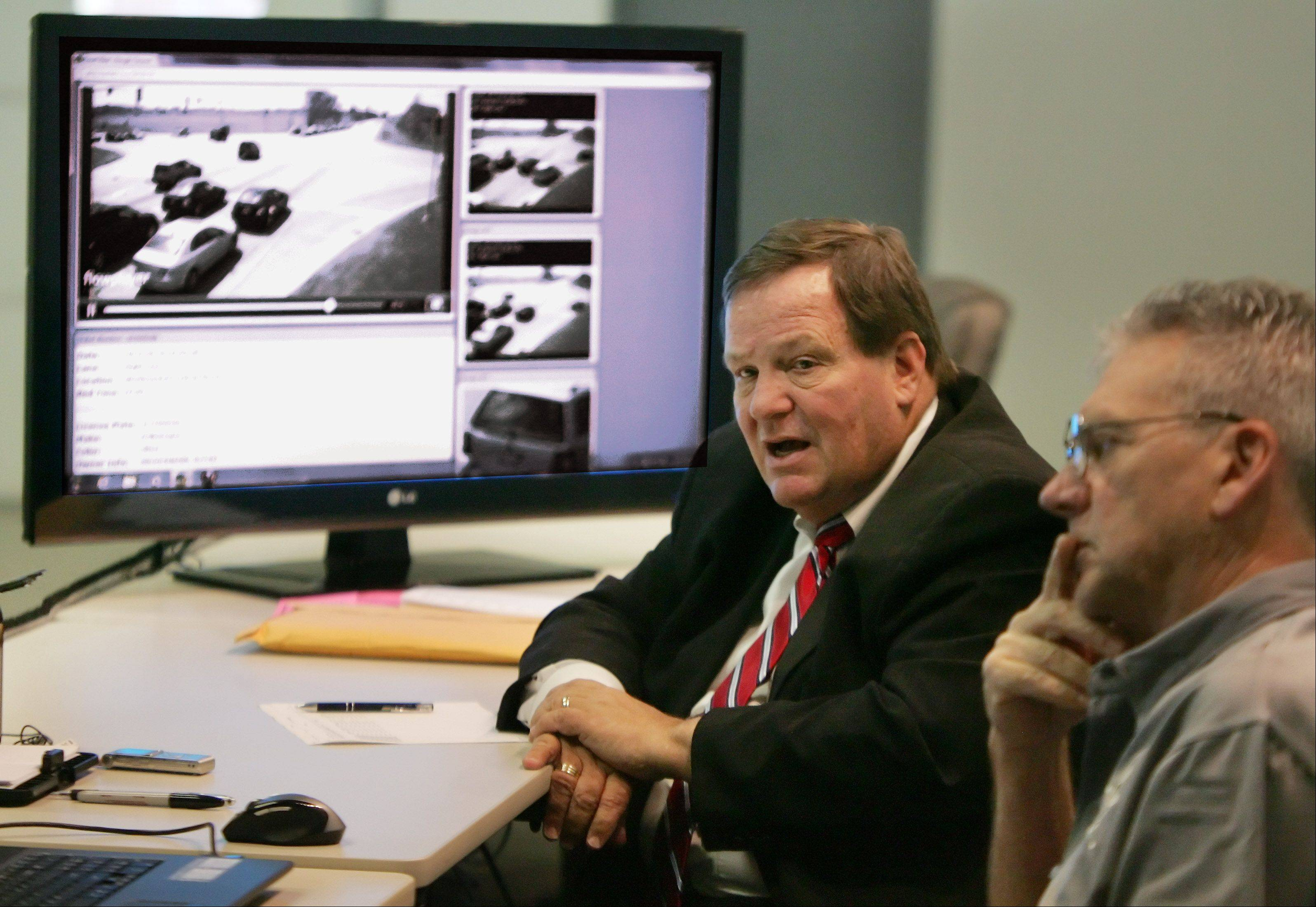 Former Lake County circuit court Chief Judge Henry Tonigan III presides over contested red-light camera violations at the Lakemoor Police Station. He also decides adjudication hearings for small ordinance violations, such as dog-at-large violations. Court administrator Terry Counley is sitting to the right.