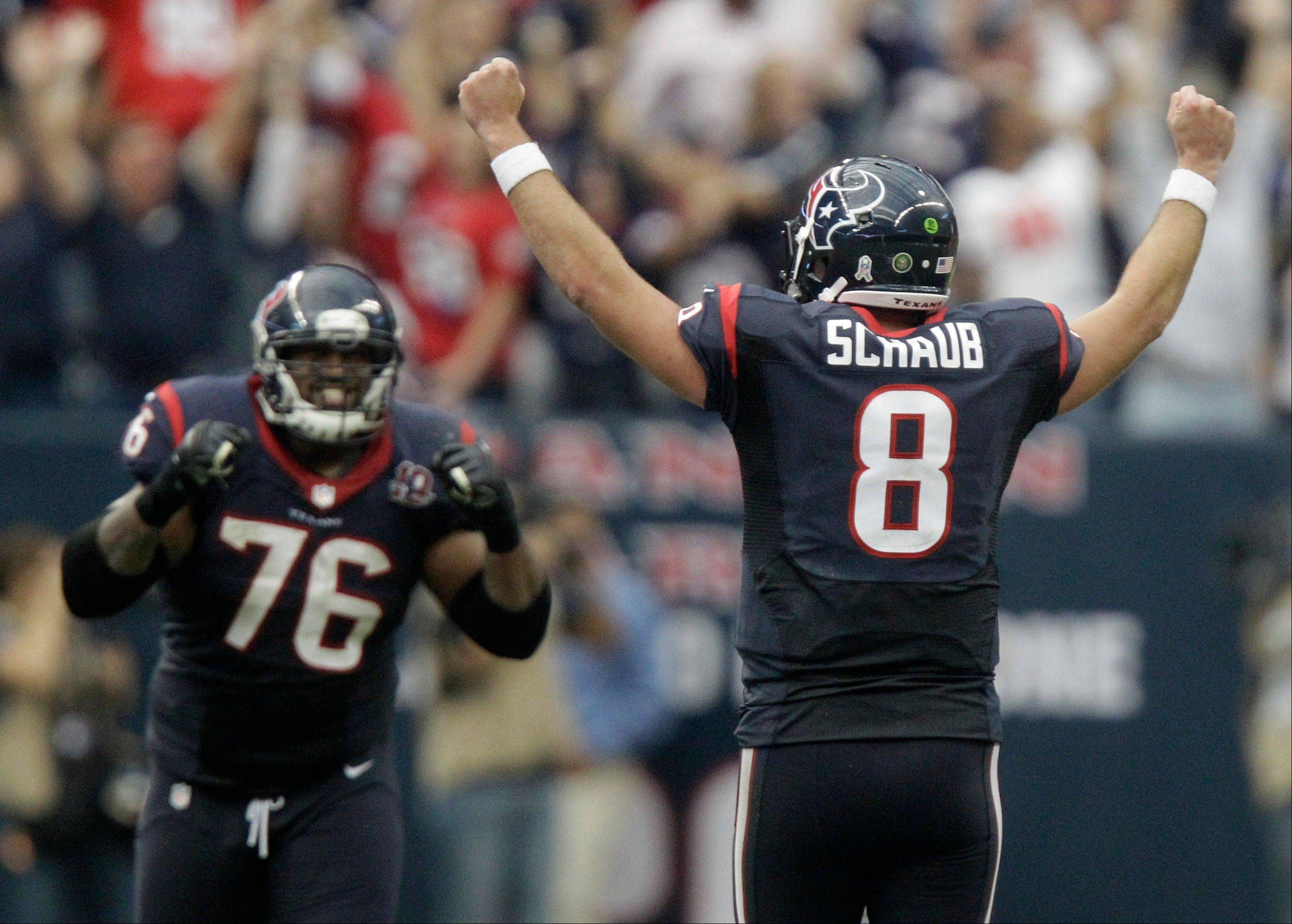 Houston Texans quarterback Matt Schaub (8) and Duane Brown (76) celebrate after beating the Jacksonville Jaguars 43-37 in overtime Sunday in Houston.