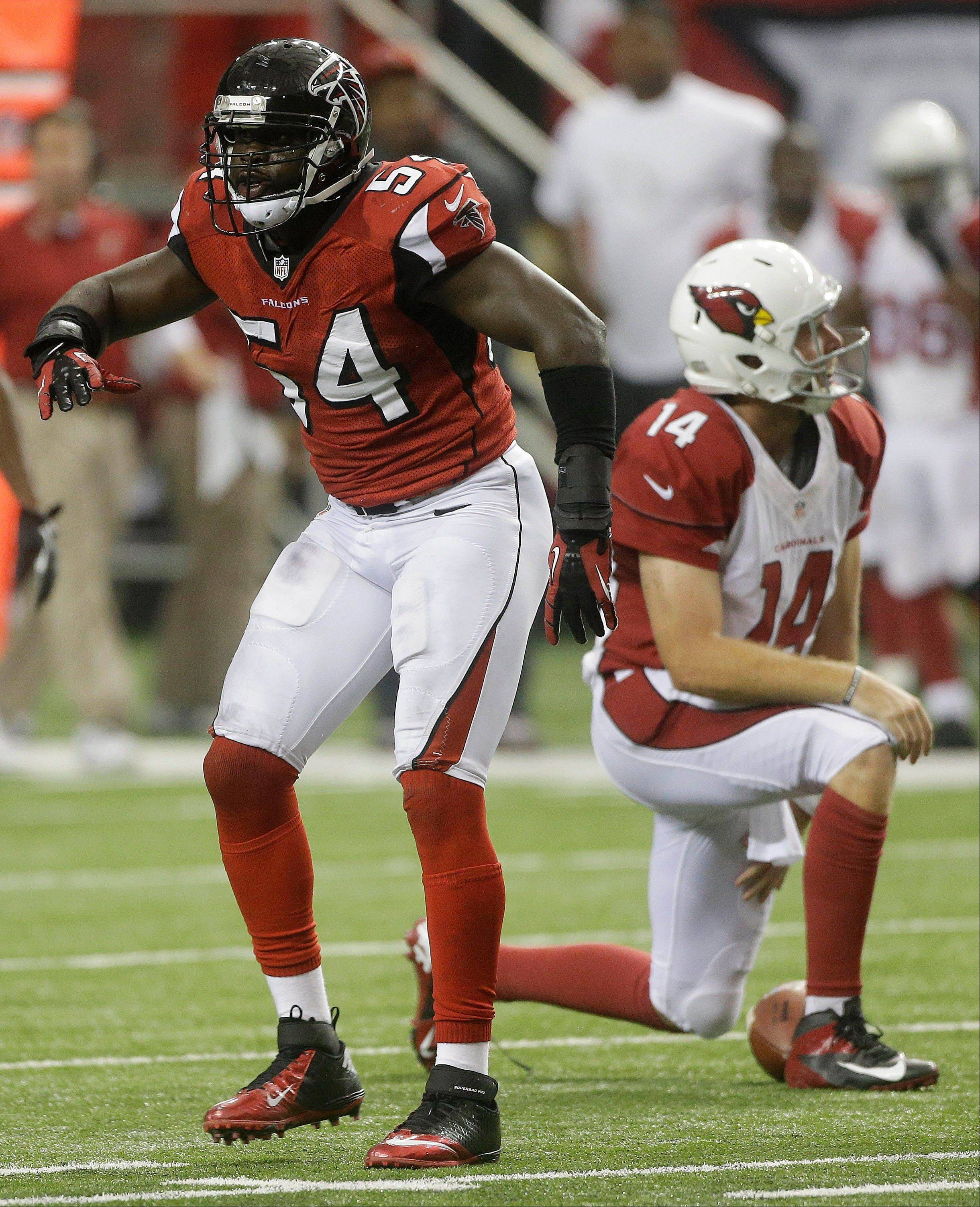 Atlanta Falcons outside linebacker Stephen Nicholas (54) sacks Arizona Cardinals quarterback Ryan Lindley (14) during the second half Sunday in Atlanta.