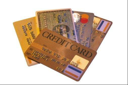 Americans cranked up their use of credit cards in the third quarter, racking up more debt than a year ago, while also being less diligent about making payments on time, an analysis of consumer-credit data shows.