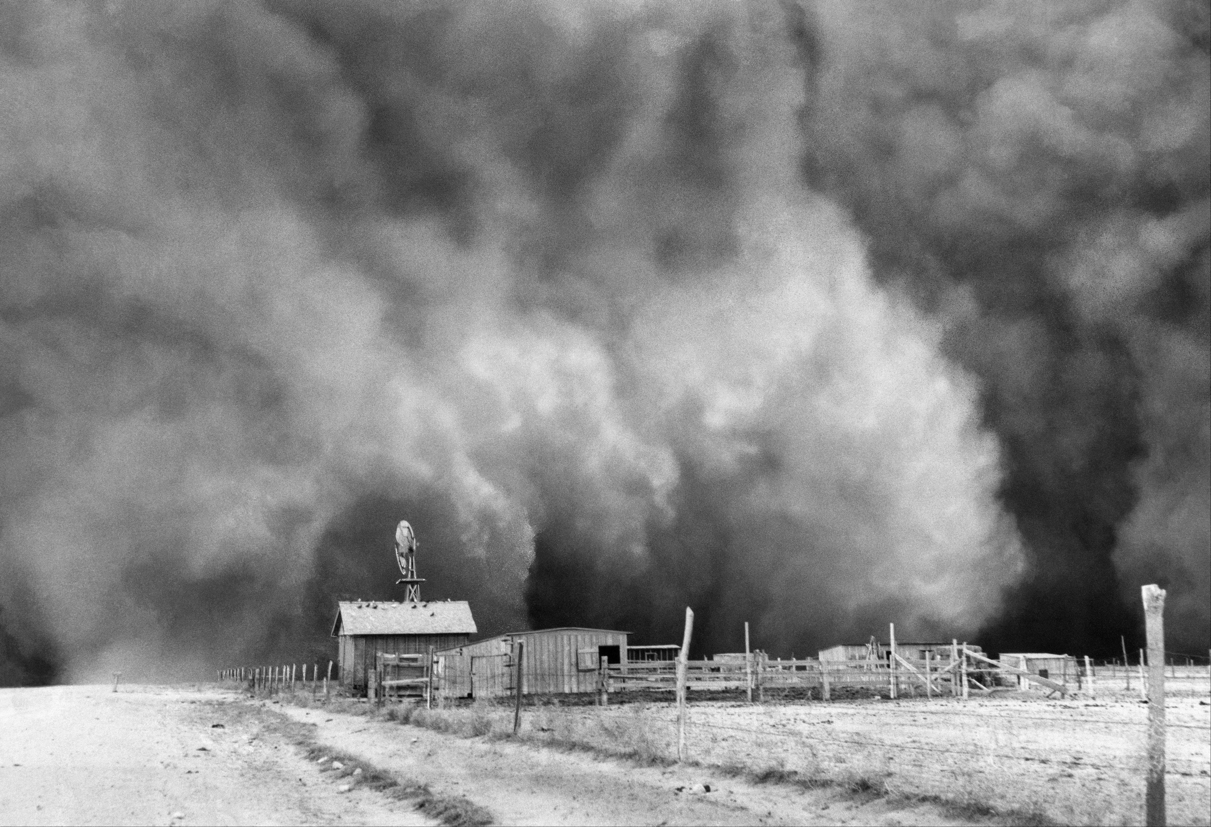 "Huge dust clouds, like this one captured in 1935 in Boise City, Okla., wiped out farms and destroyed families during the Great Depression. Survivors of the dust storms of the 1930s tell their stories in Ken Burns' oral history documentary ""The Dust Bowl,"" which airs Sunday and Monday, Nov. 18-19, on PBS."