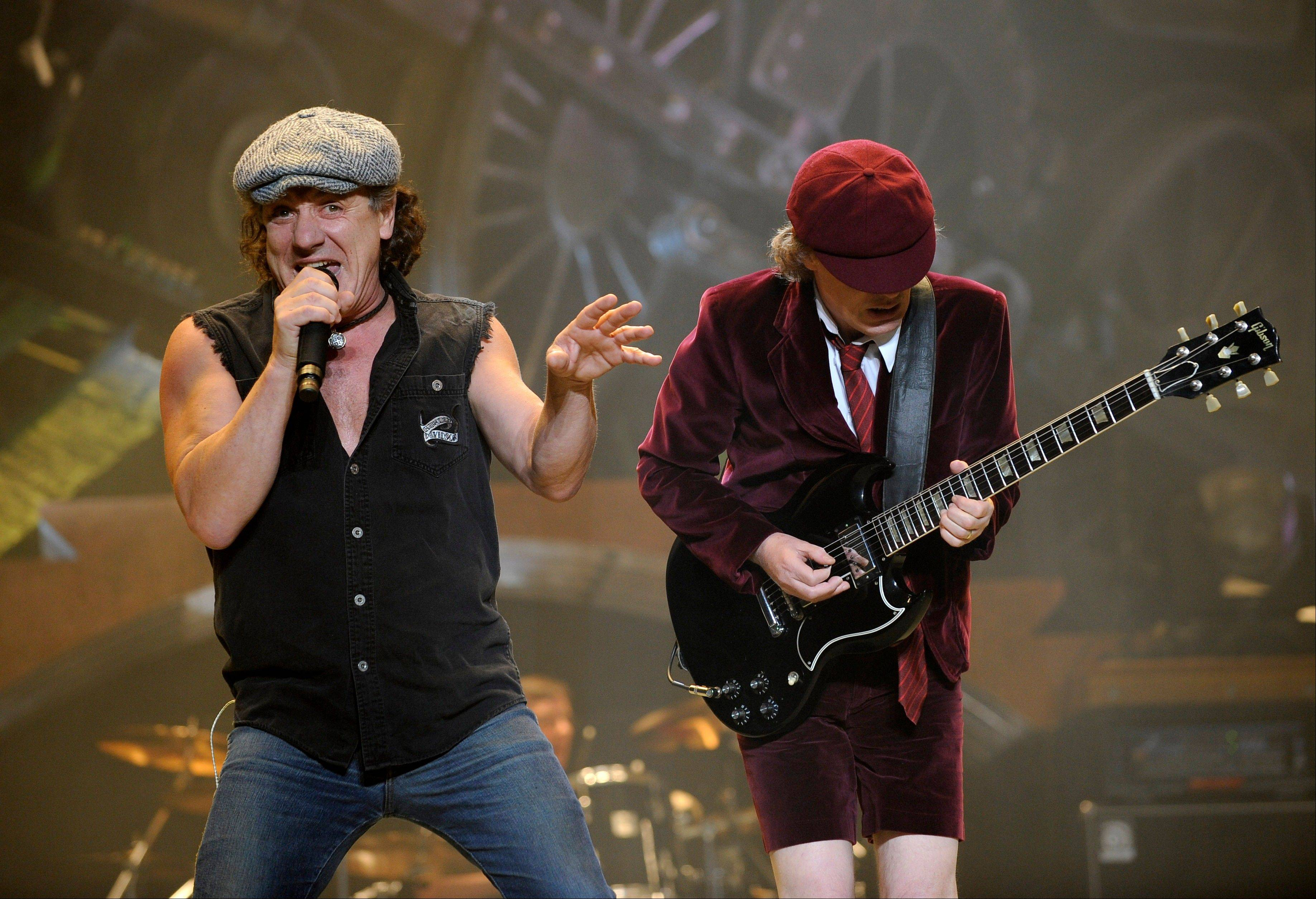 AC/DC lead singer Brian Johnson, left, and Angus Young perform on the Black Ice tour at Madison Square Garden in New York. Columbia Records and Apple announced Monday that the classic rock band�s music will be available at the iTunes Store worldwide.