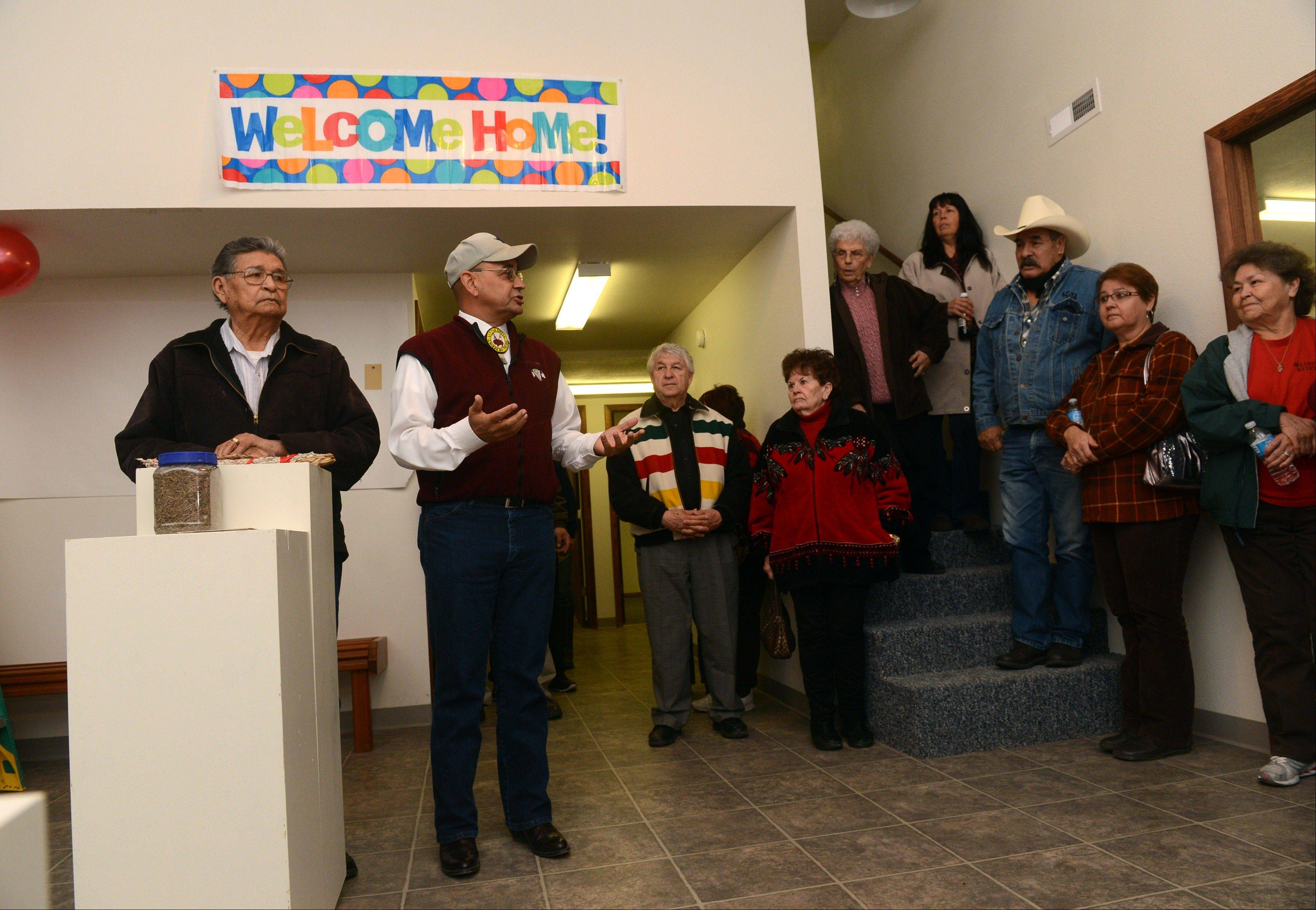 FHenry Anderson, left, and James Parker Shield welcome people to the new Little Shell Chippewa Cree Visitor Center in Montana.