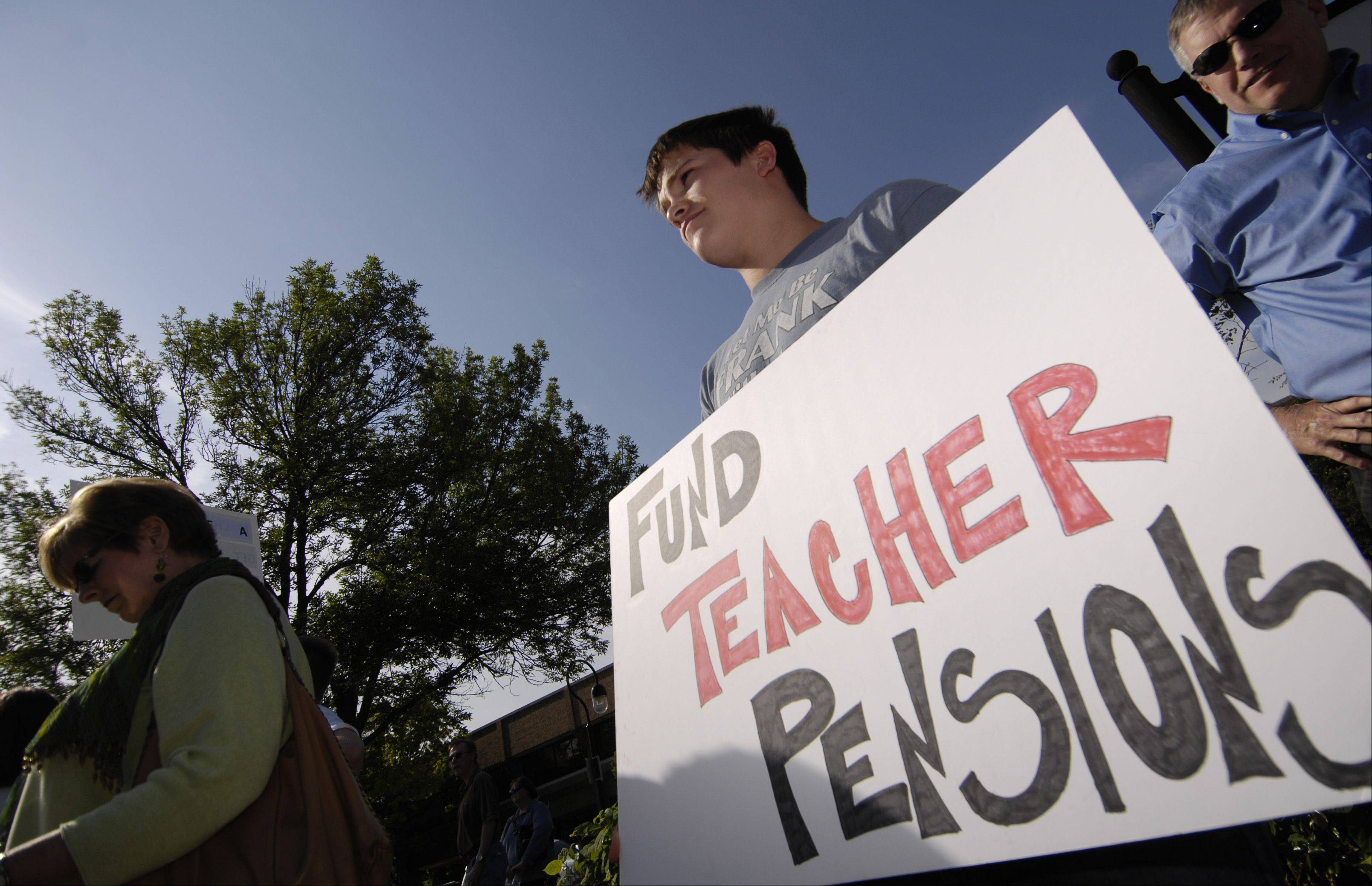 Protesters rallied in Naperville earlier this year to voice opposition to proposed cuts in teacher pensions.