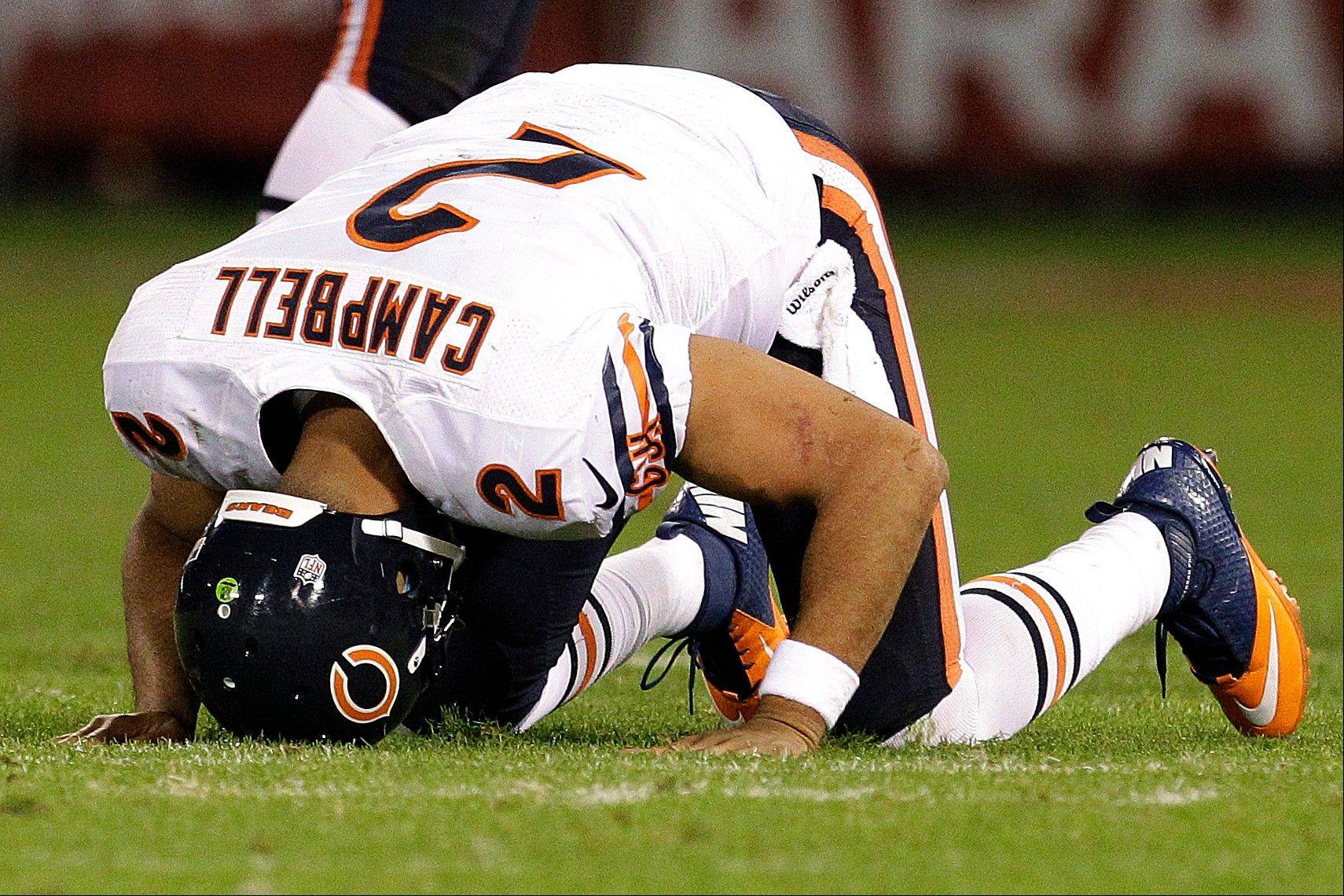 Bears quarterback Jason Campbell gets off the ground after being tackled in Monday's second half in San Francisco.