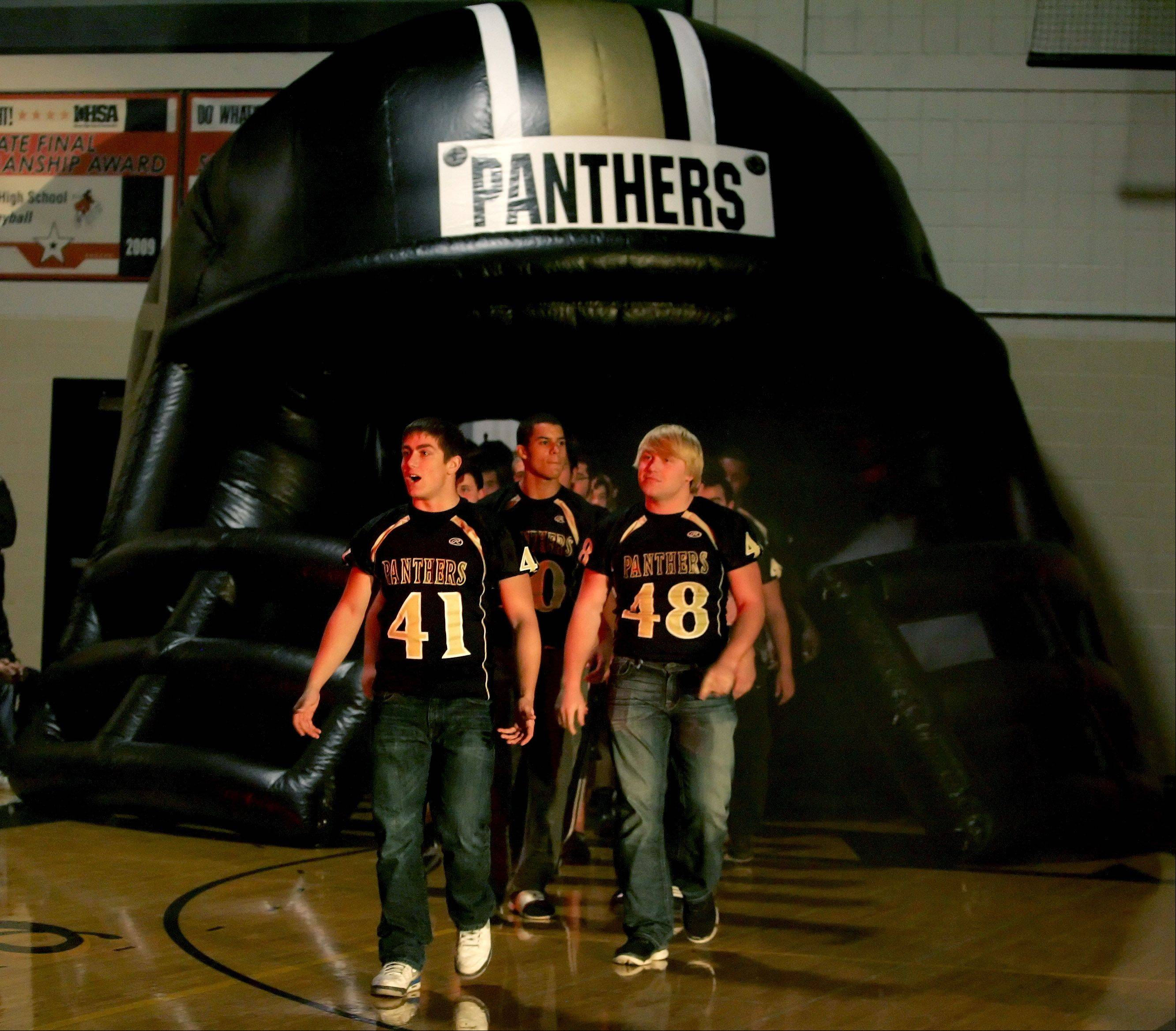 The Glenbard North football team makes its entrance for a pep rally Tuesday in Carol Stream. The team will play Mt. Carmel Saturday in Champaign for the Class 8A State Championship.