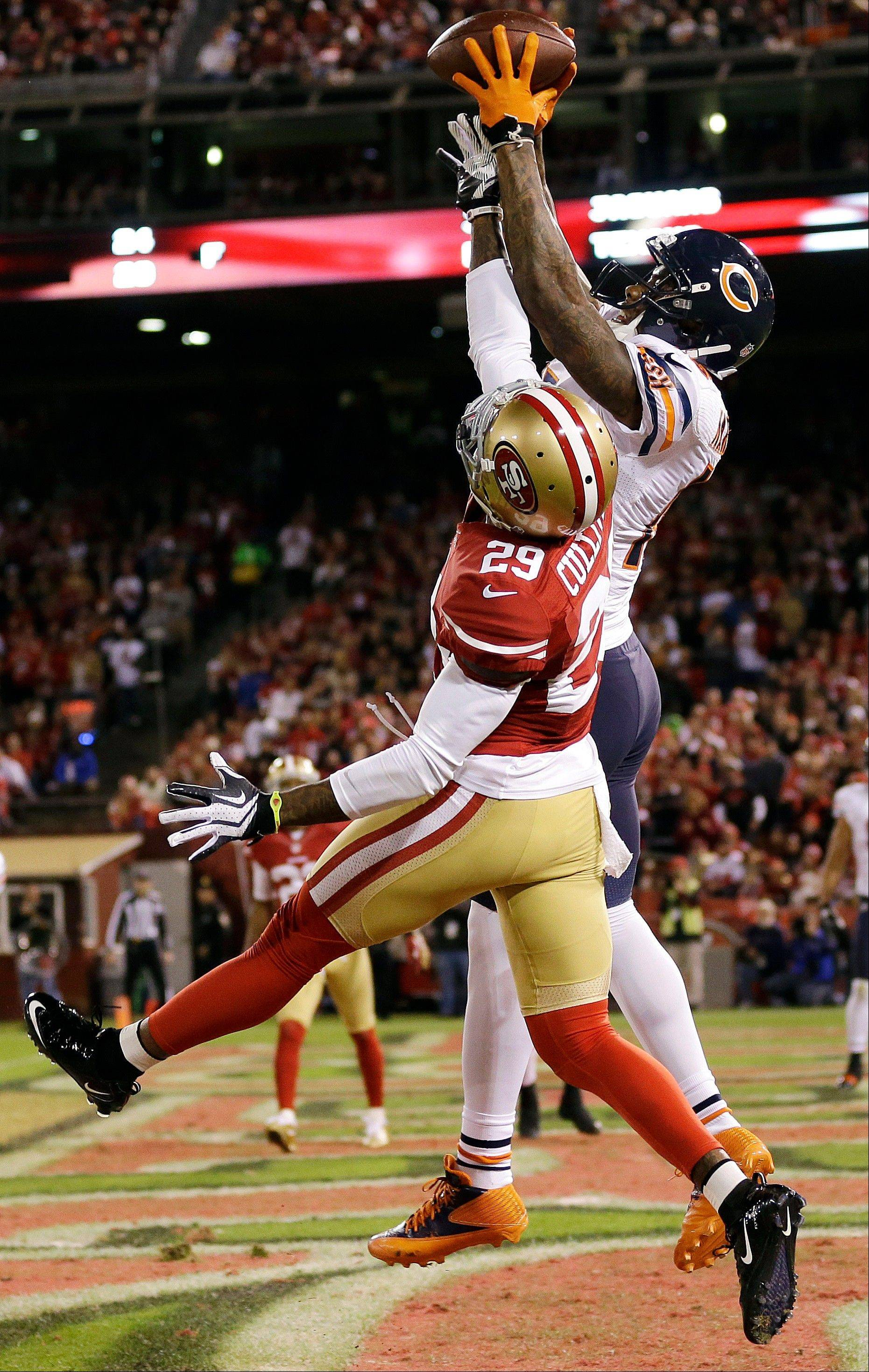 Bears wide receiver Brandon Marshall catches a 13-yard touchdown pass over San Francisco 49ers cornerback Chris Culliver during Monday's third quarter in San Francisco.