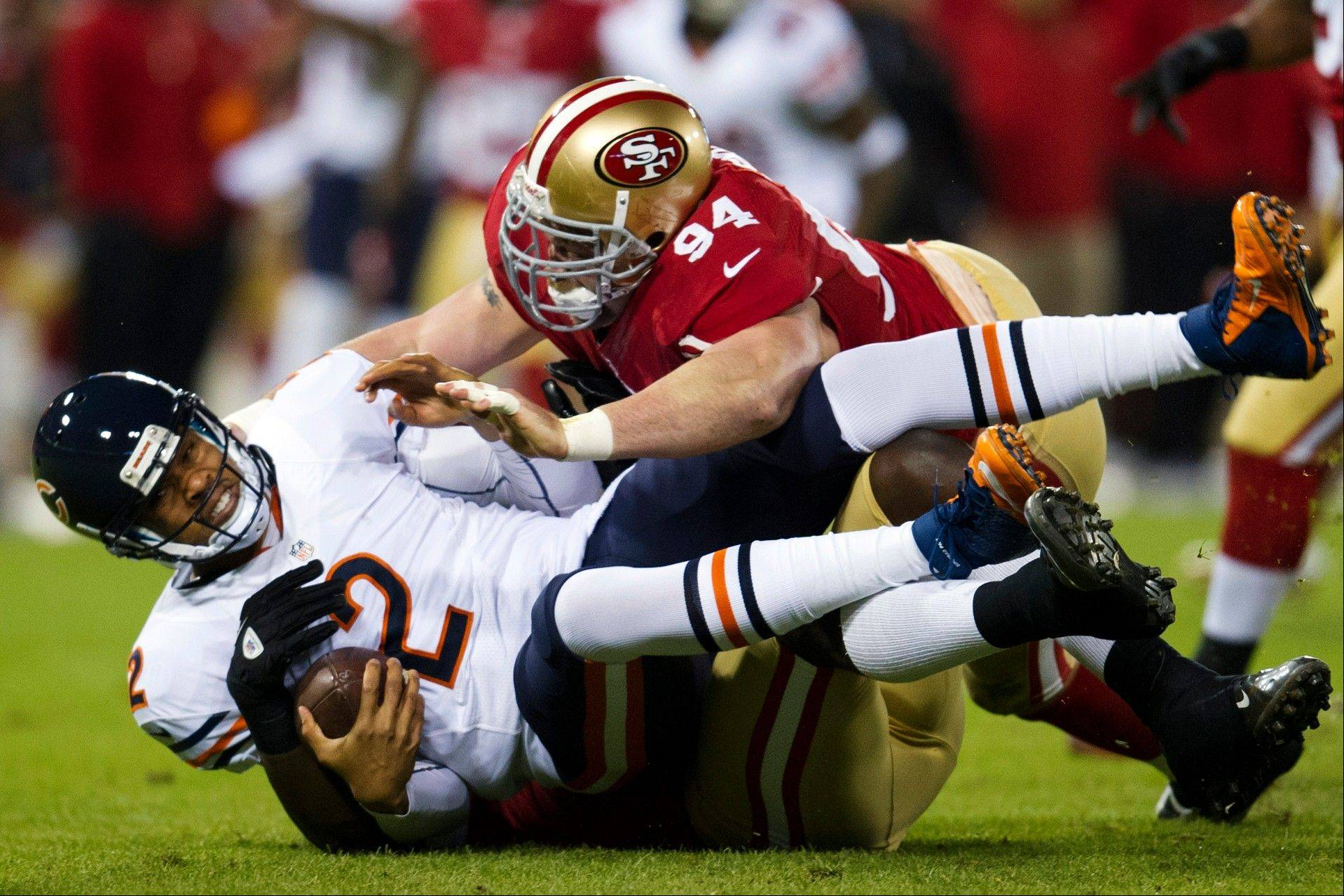 San Francisco 49ers outside linebacker Aldon Smith, obscured, and defensive end Justin Smith sack Bears quarterback Jason Campbell in Monday�s first quarter in San Francisco.
