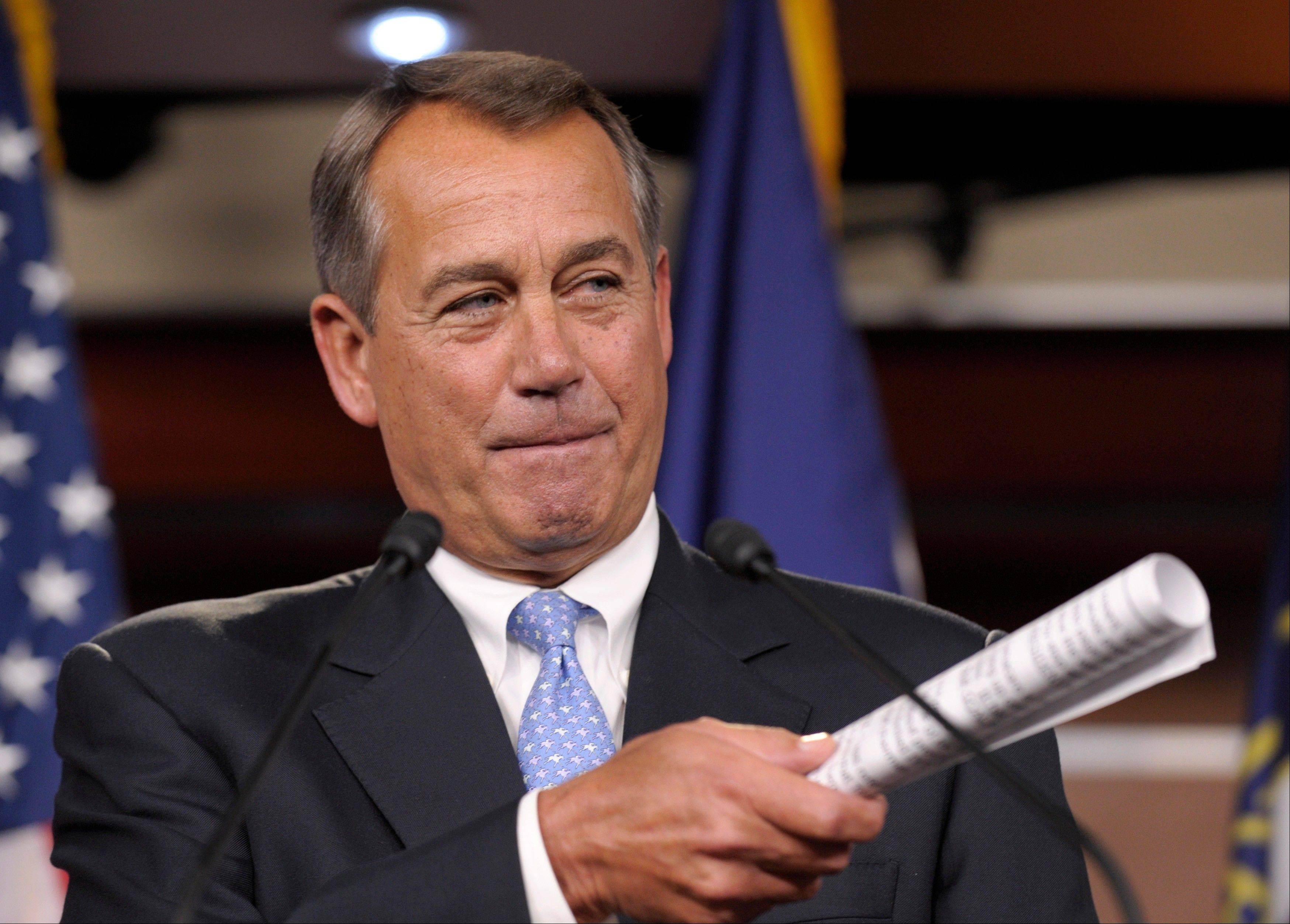 House Speaker John Boehner of Ohio gesturing during a news conference on Capitol Hill in Washington. It's entirely possible that lawmakers and the White House will reach a deal to avert an avalanche of tax increases and deep cuts in government programs before a Jan. 1 deadline.