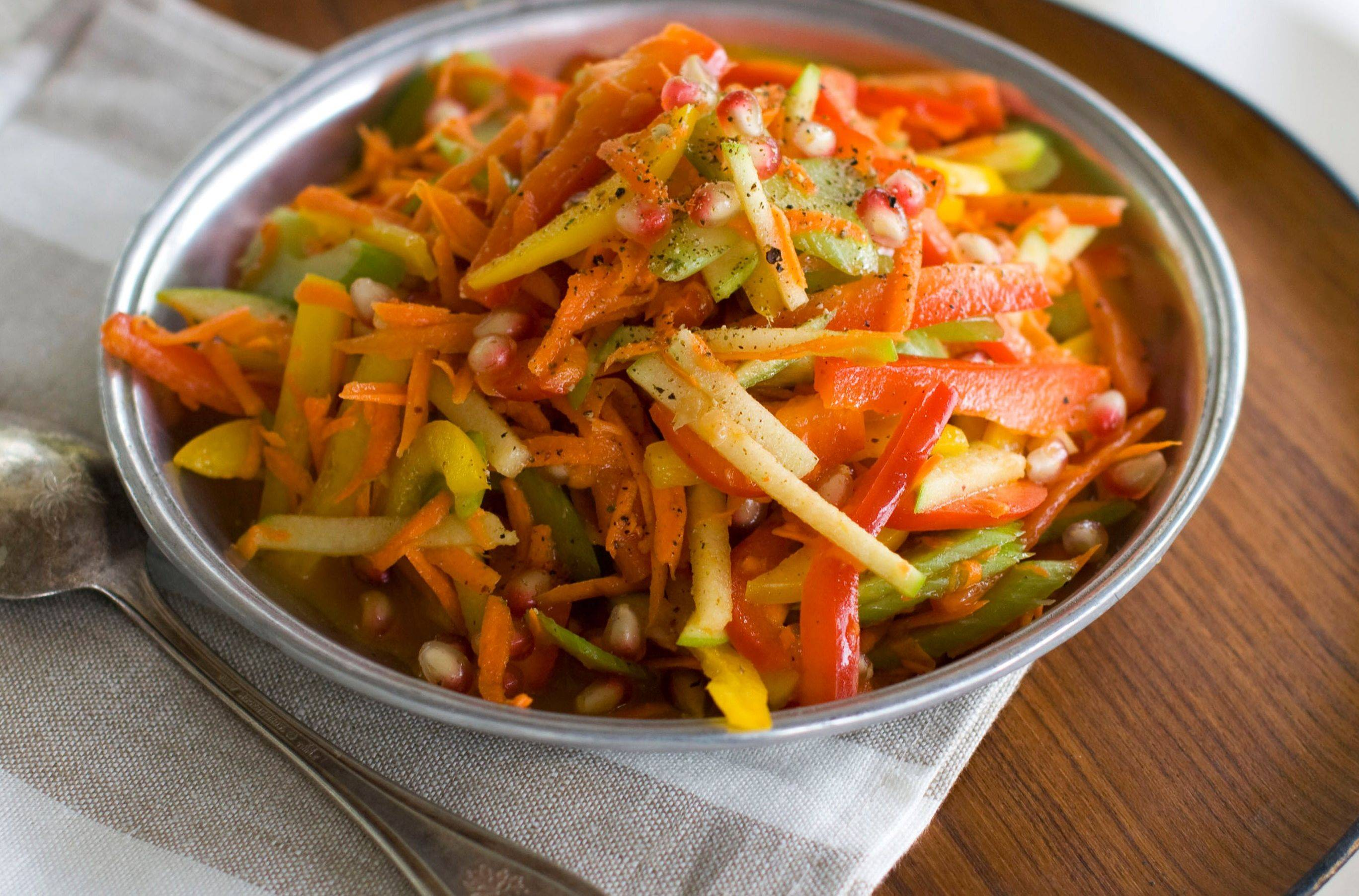 Red bell pepper and apple slaw (also called Celebration Slaw) provides a colorful dish for your holiday table.