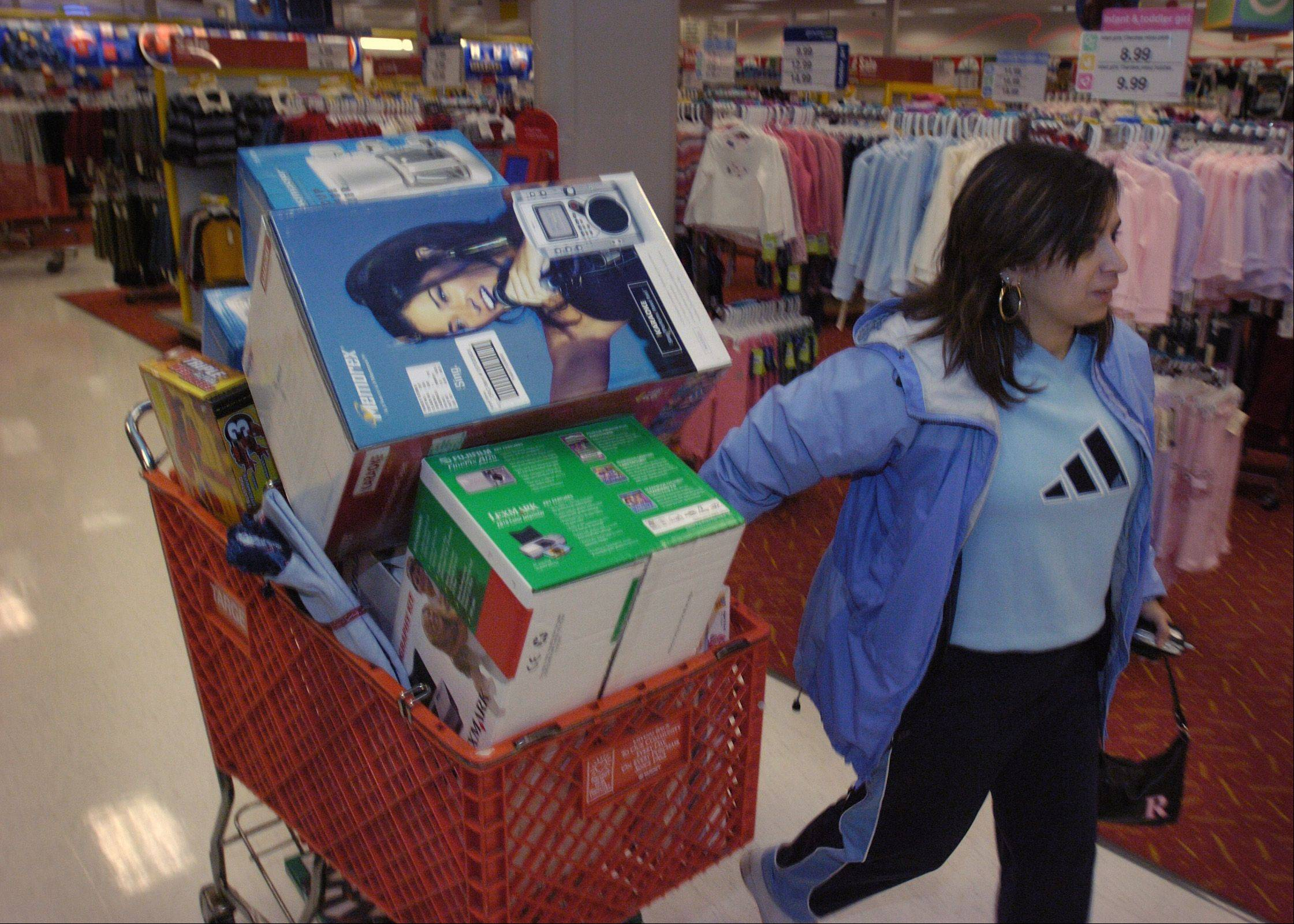 Rafaela Garcia of South Elgin had her shopping cart overflowing at the Target store in West Dundee on a previous Black Friday. This year, Target stores will open their doors at 9 p.m. Thanksgiving Day.