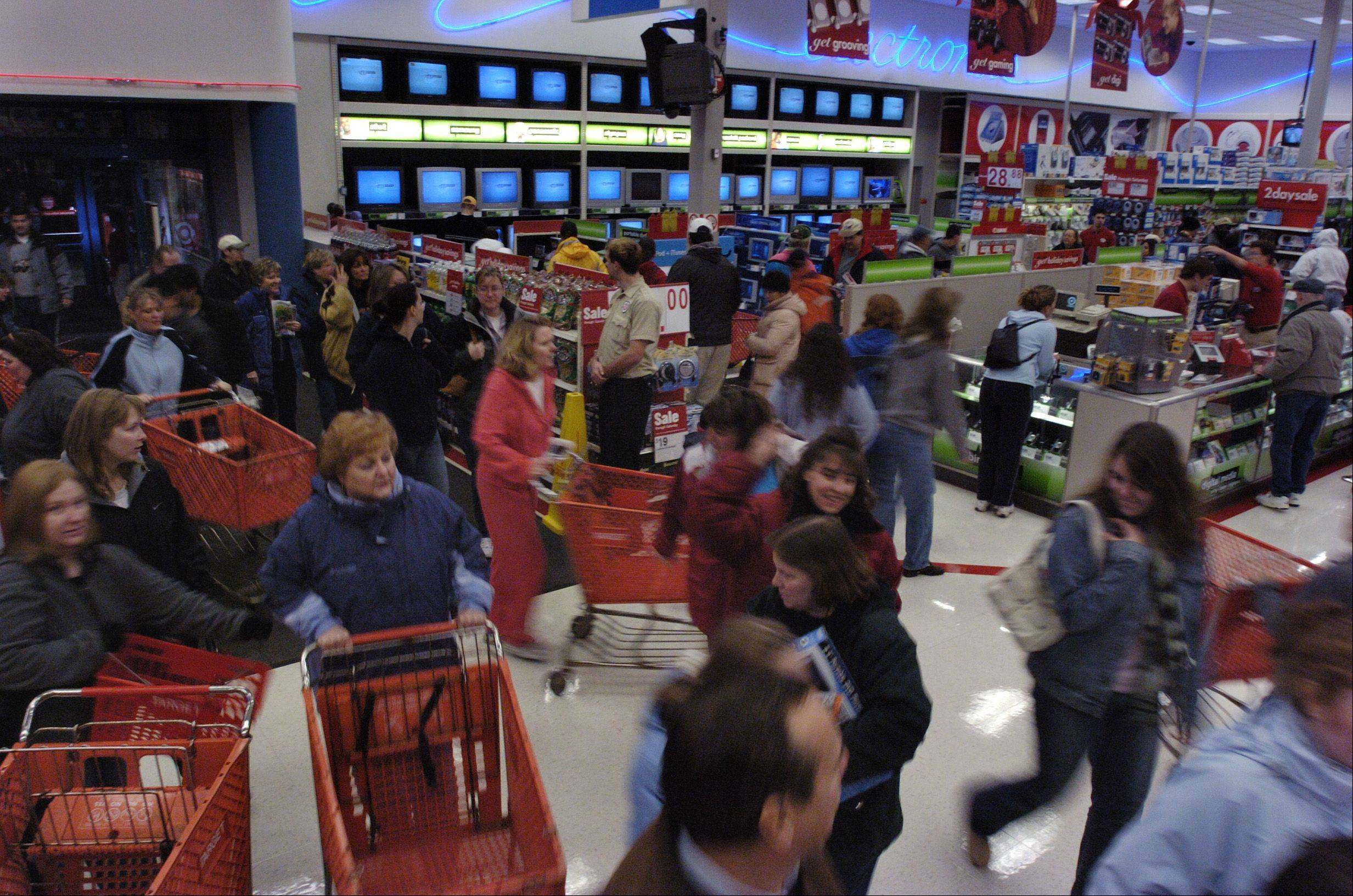 Shoppers pour into the Target store in West Dundee in hopes of getting the first bargains of the holiday shopping season.
