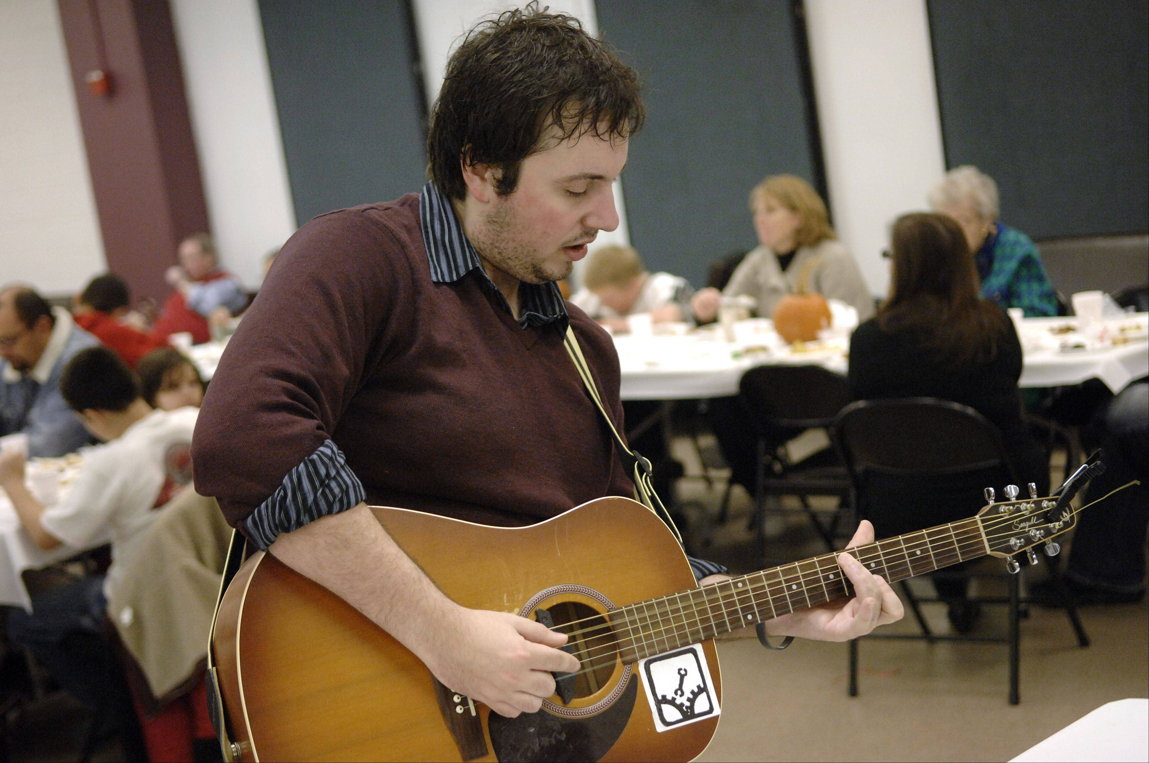 Jesse Greco of Elgin plays requests for diners at last year's Thanksgiving Community Dinner in Elgin.