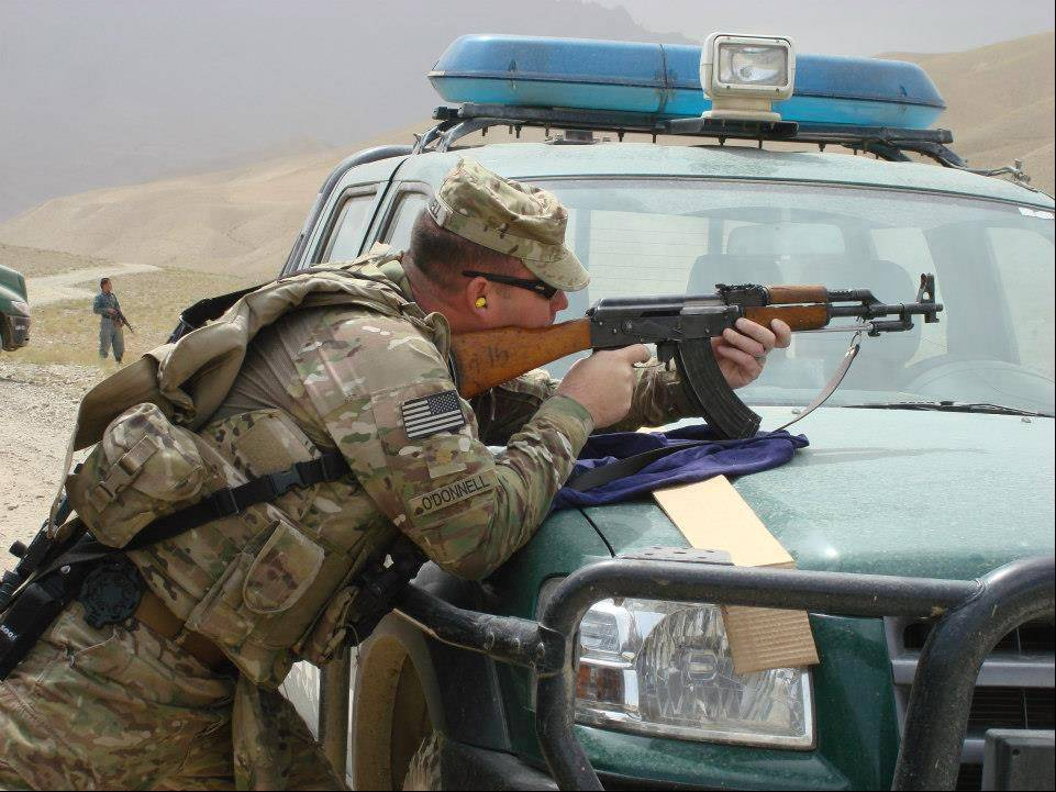 DuPage County Assistant State's Attorney Mike O'Donnell fires an AK-47 at a range in Bamyan province, Afghanistan.
